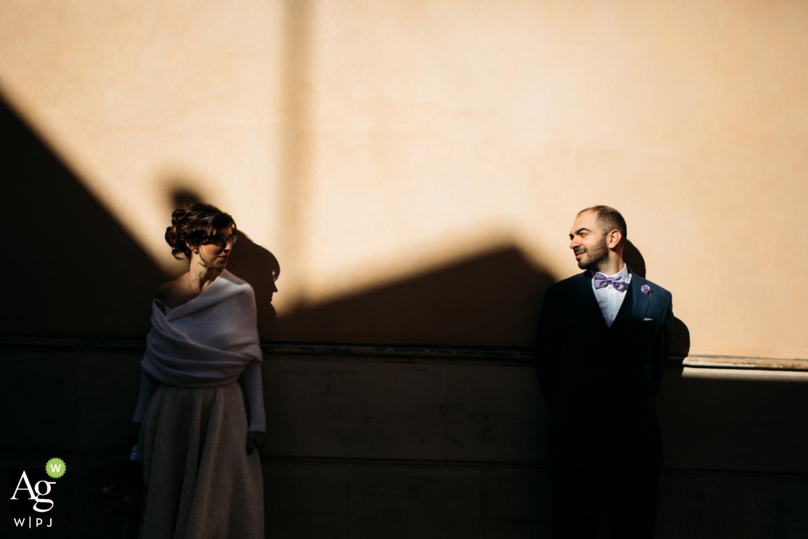 Syracuse, Sicily artistic wedding couple portrait using light and shadow