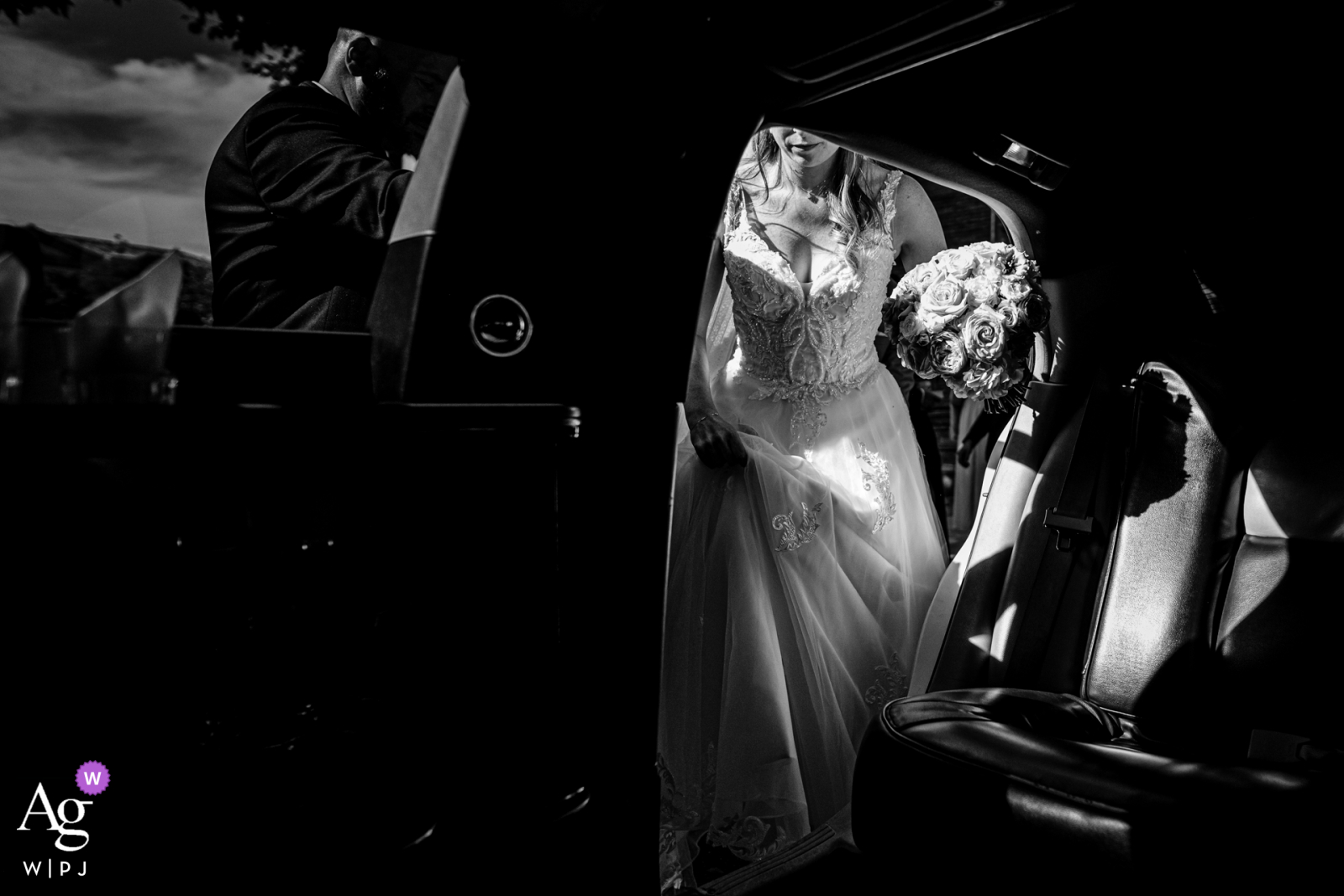 The bride gets into the limo for her Château de Nolet, Aucamville, France wedding