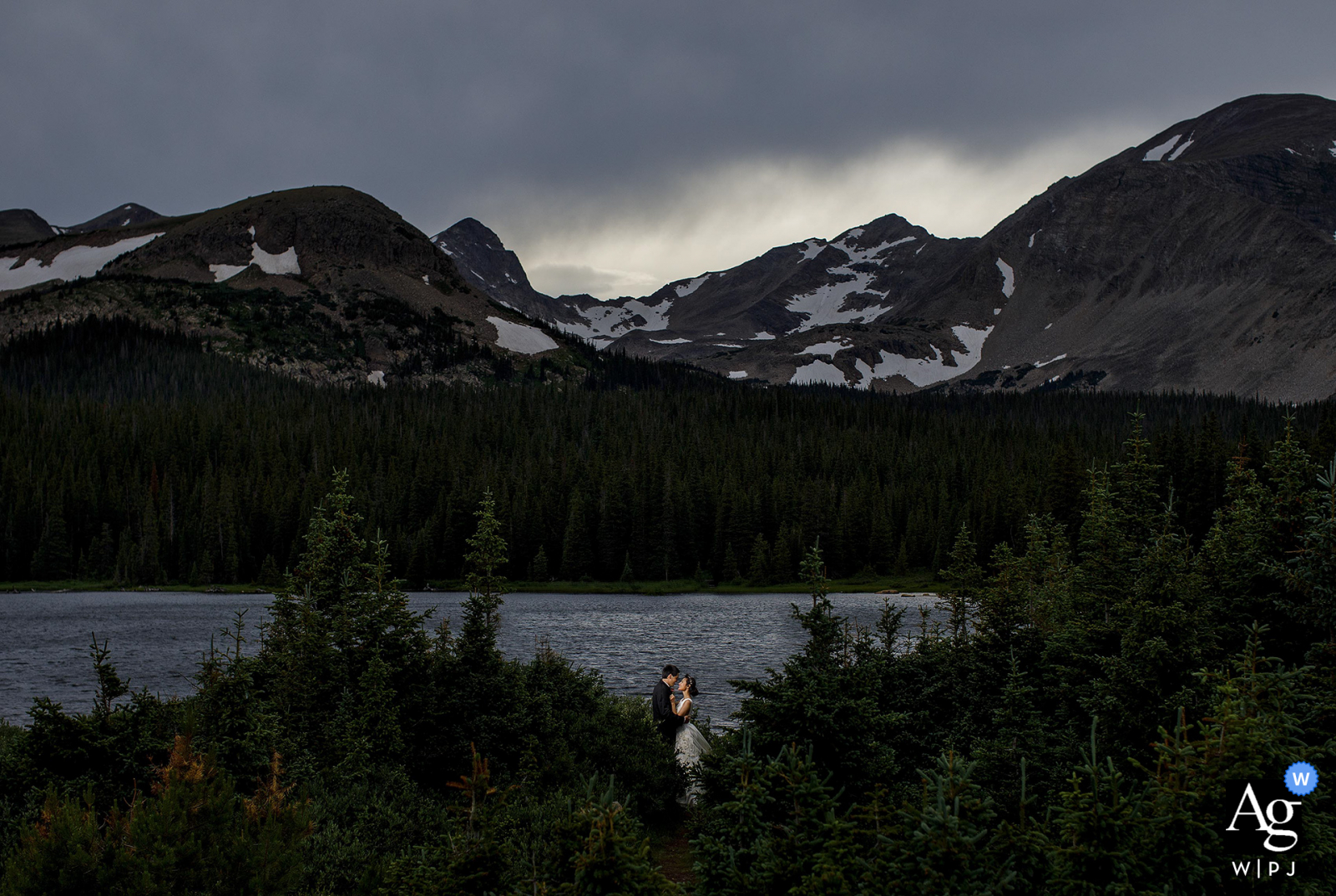 The bride and groom pose together for a wedding portrait near Brainard Lake during their Colorado mountain elopement