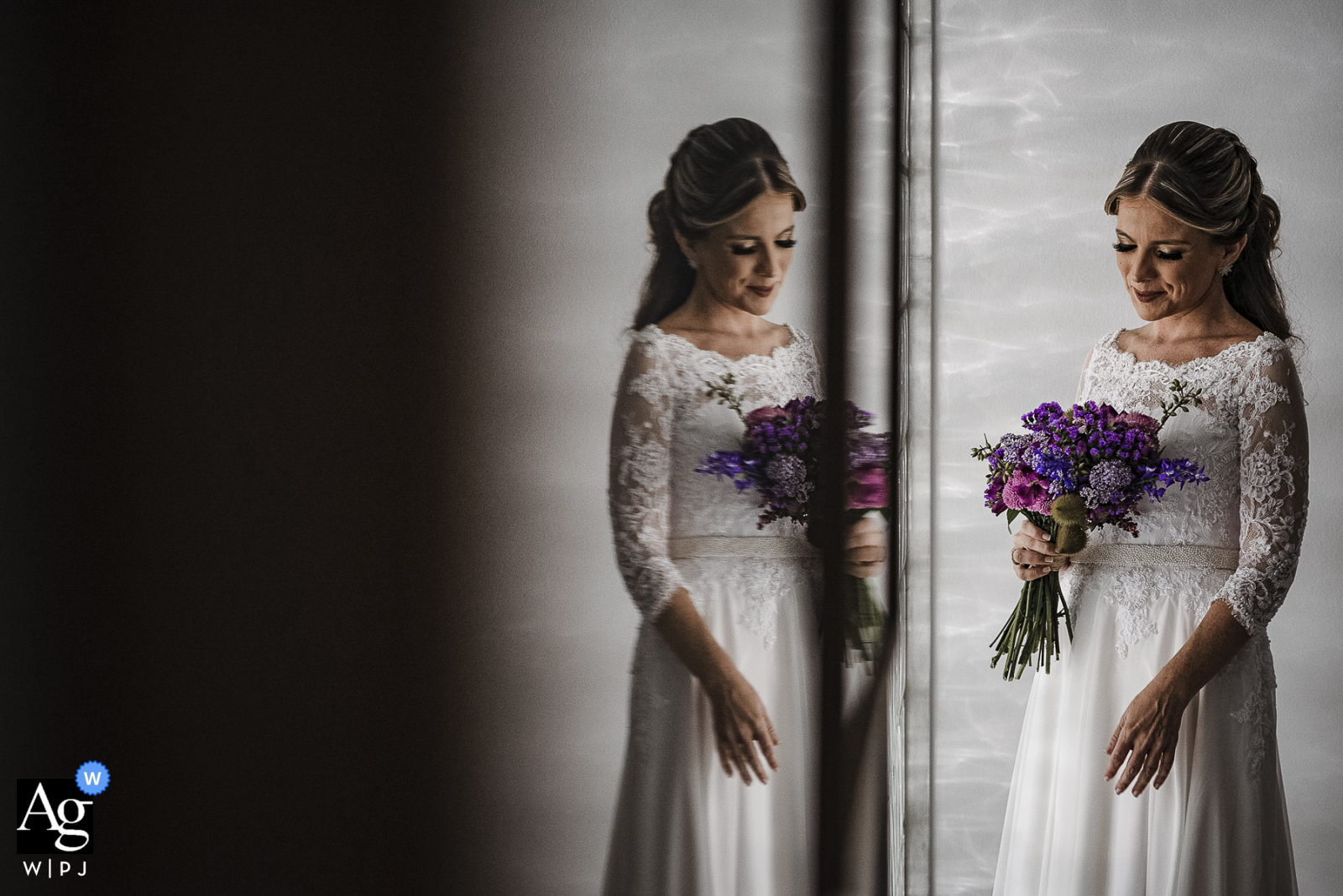 Casa da Noiva, Rio de Janeiro artistic wedding image of the bride holding her flowers and reflected in dark glass