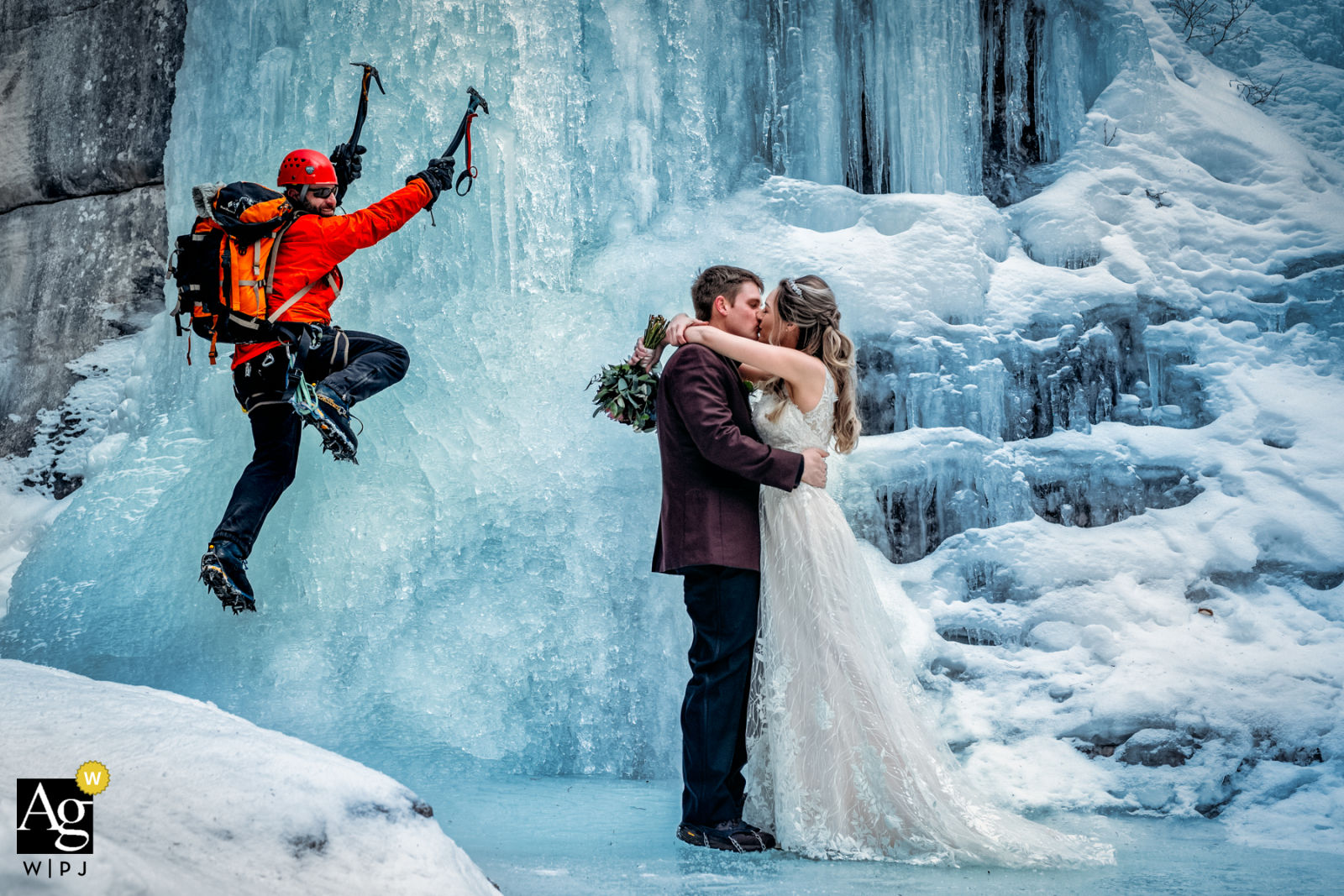 Bride and groom and ice climber in an artistic wedding photo from Maligne Canyon, AB, Canada