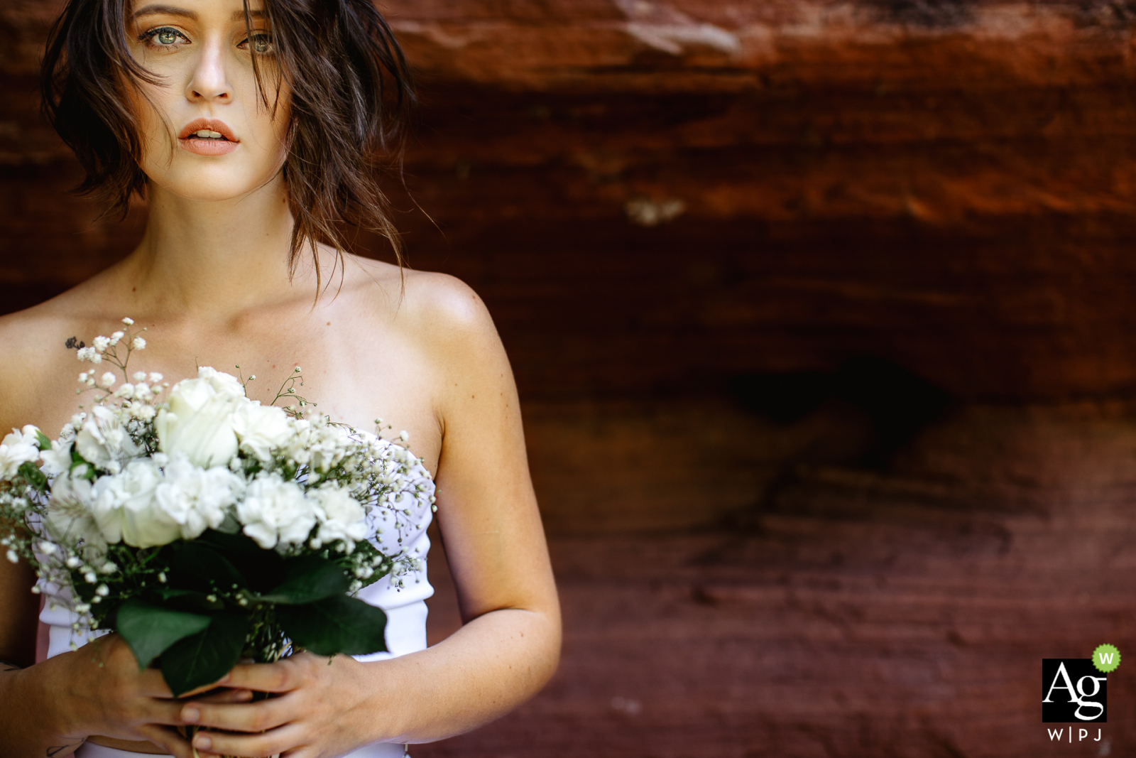 Minas do Camaquã, Brazil creative wedding day portrait of the Bride holding her flower Bouquet