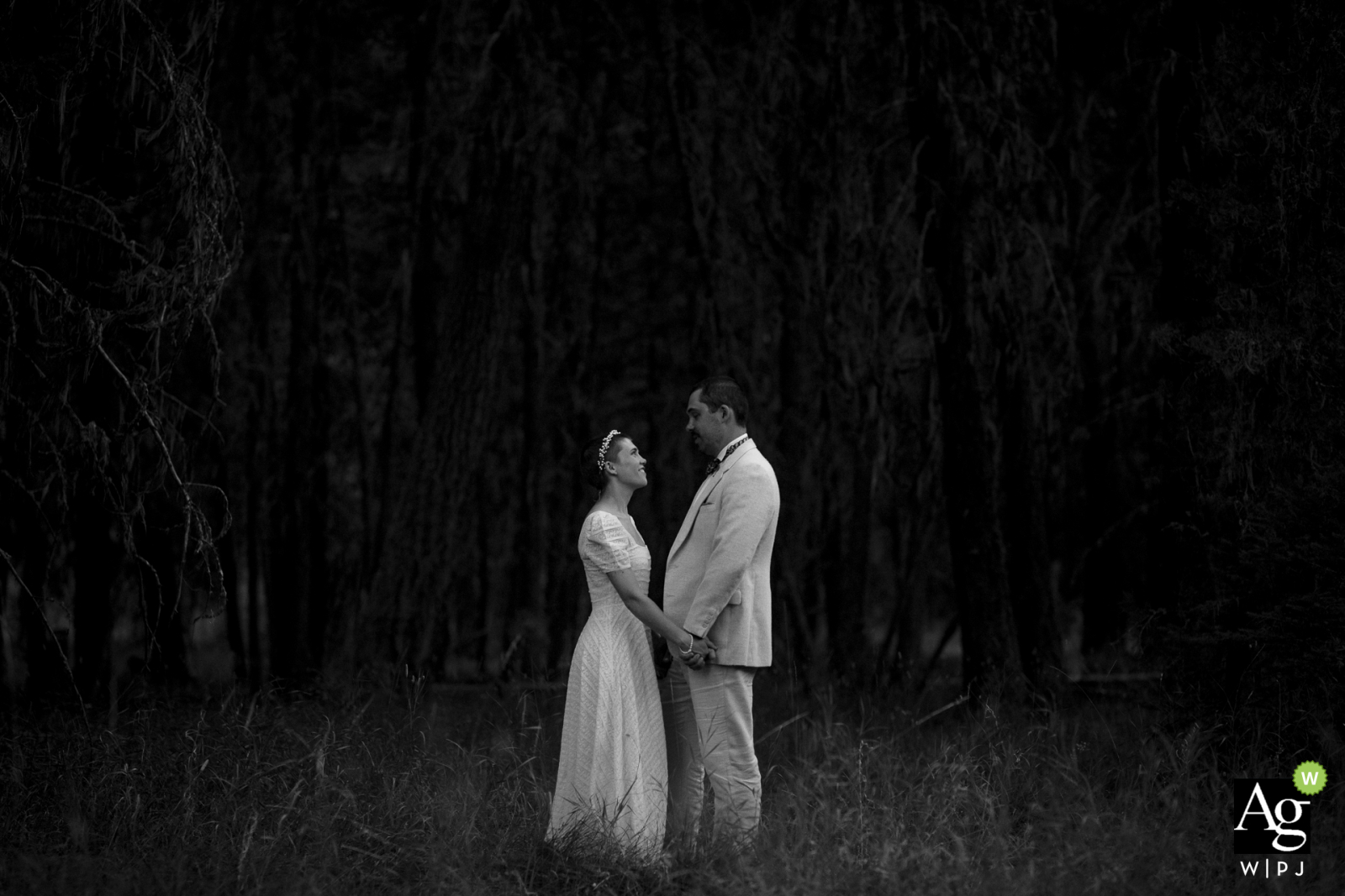 Rock Creek, MT black and white wedding portrait of the couple standing against an all black background