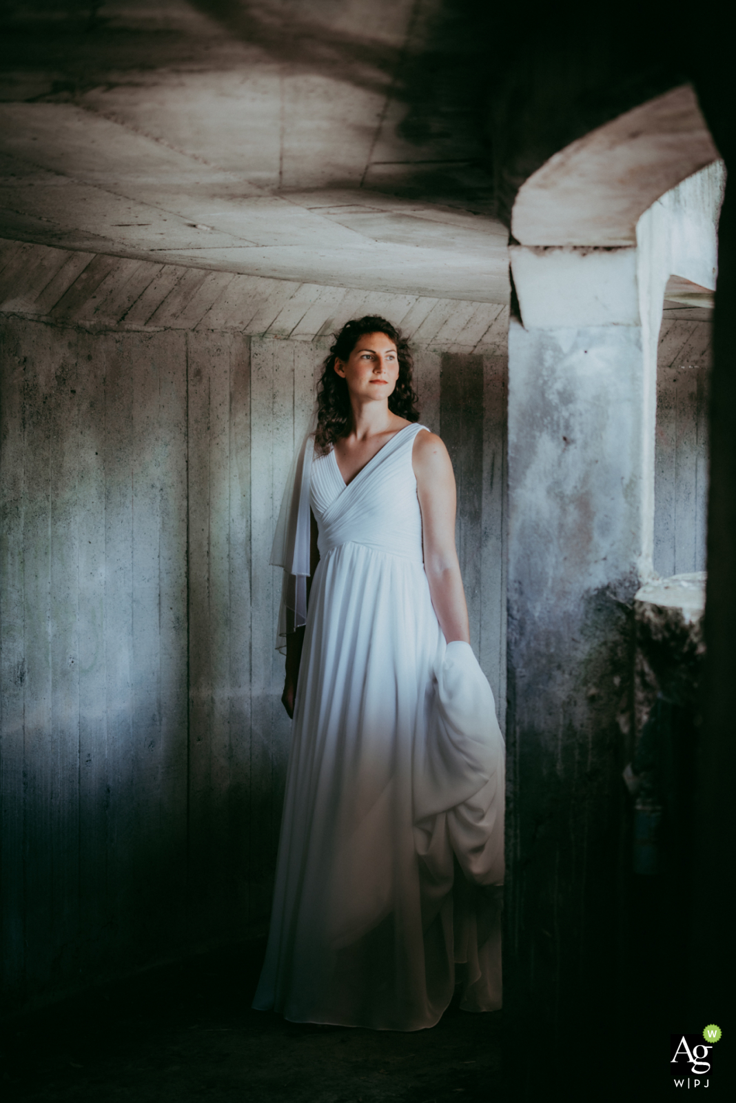 Shaanxi artistic wedding couple portrait created as the Bride poses in an old army shelter