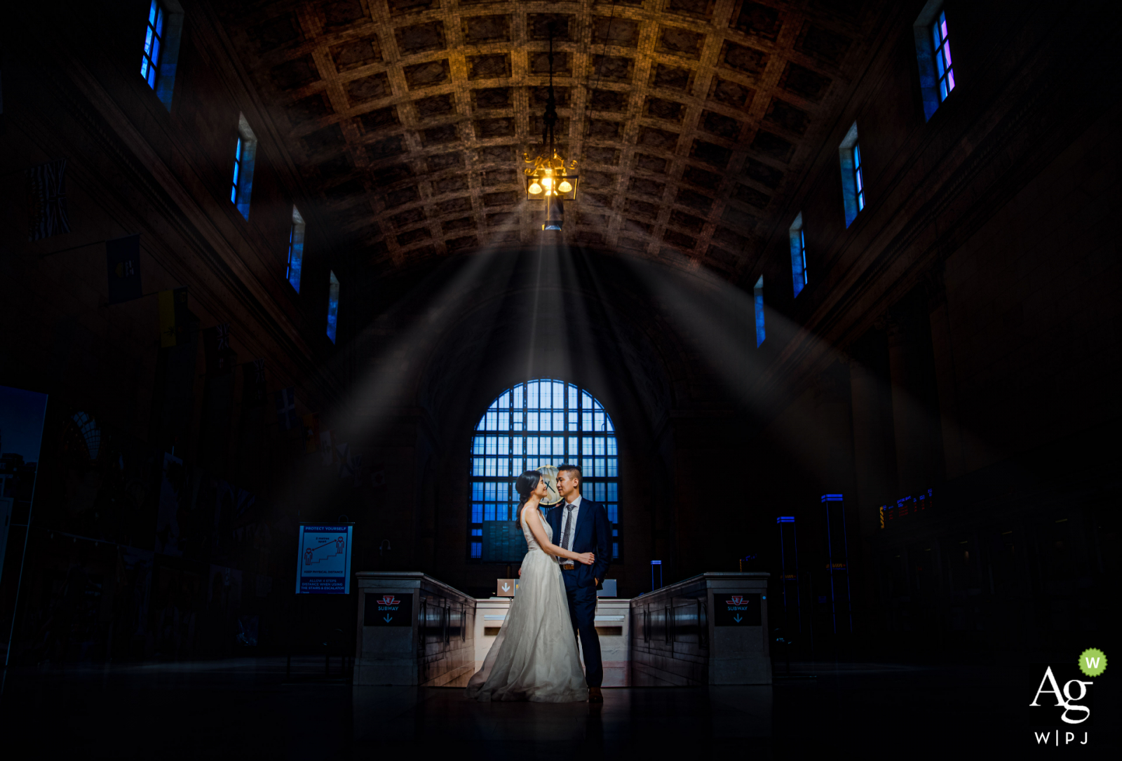 Toronto creative wedding day portrait of the couple center framed under the building Lights