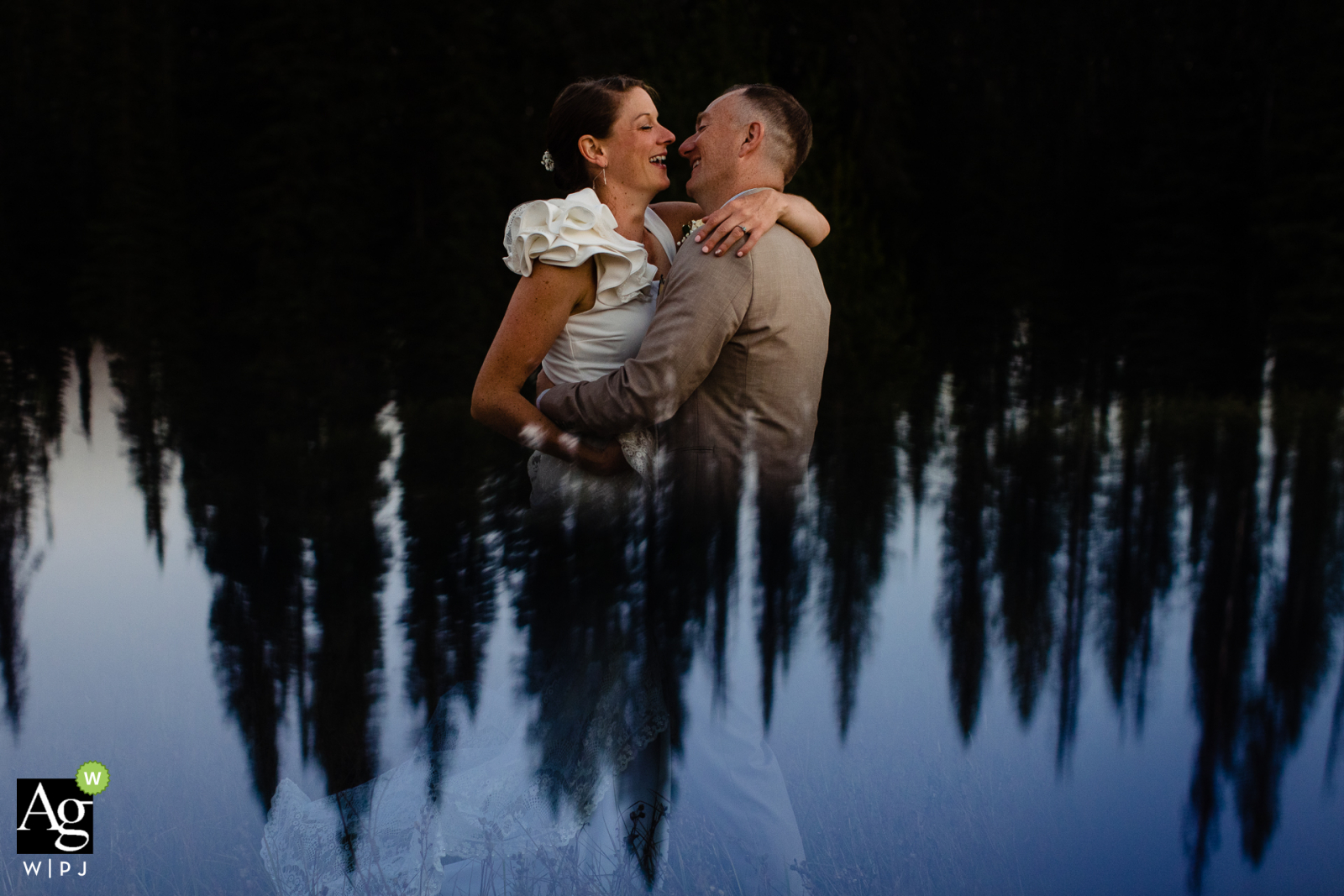 Lolo Pass, Idaho fine art wedding portrait image of the bride/groom with some trees and a great reflection