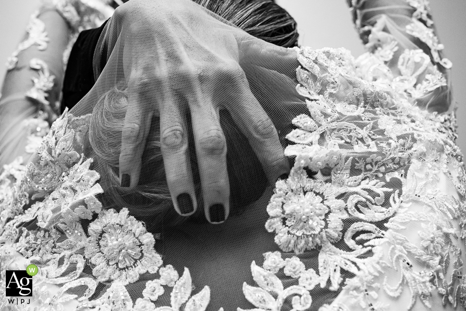 Hotel Belmond Copacabana Palace, Rio de Janeiro, Brazil fine art wedding detail photography picture showing the bride getting a helping hand while getting into her dress