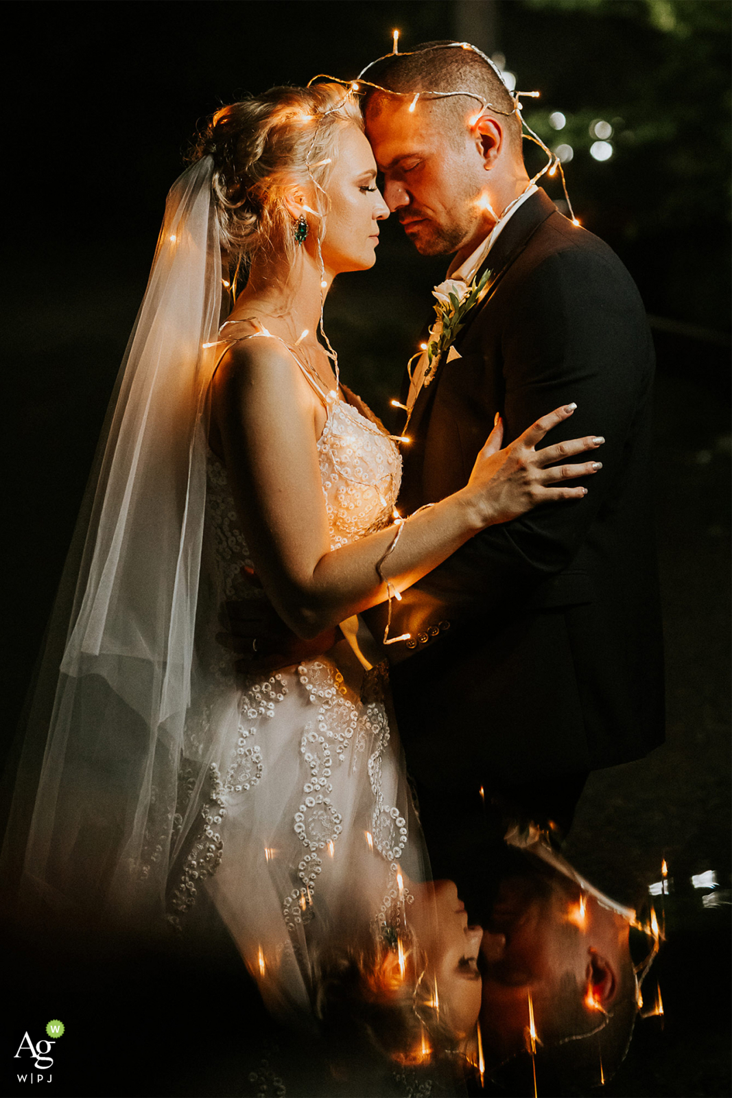 Banska Bystrica, Slovakia artistic wedding couple portrait of the Bride and Groom using tea lights and reflections