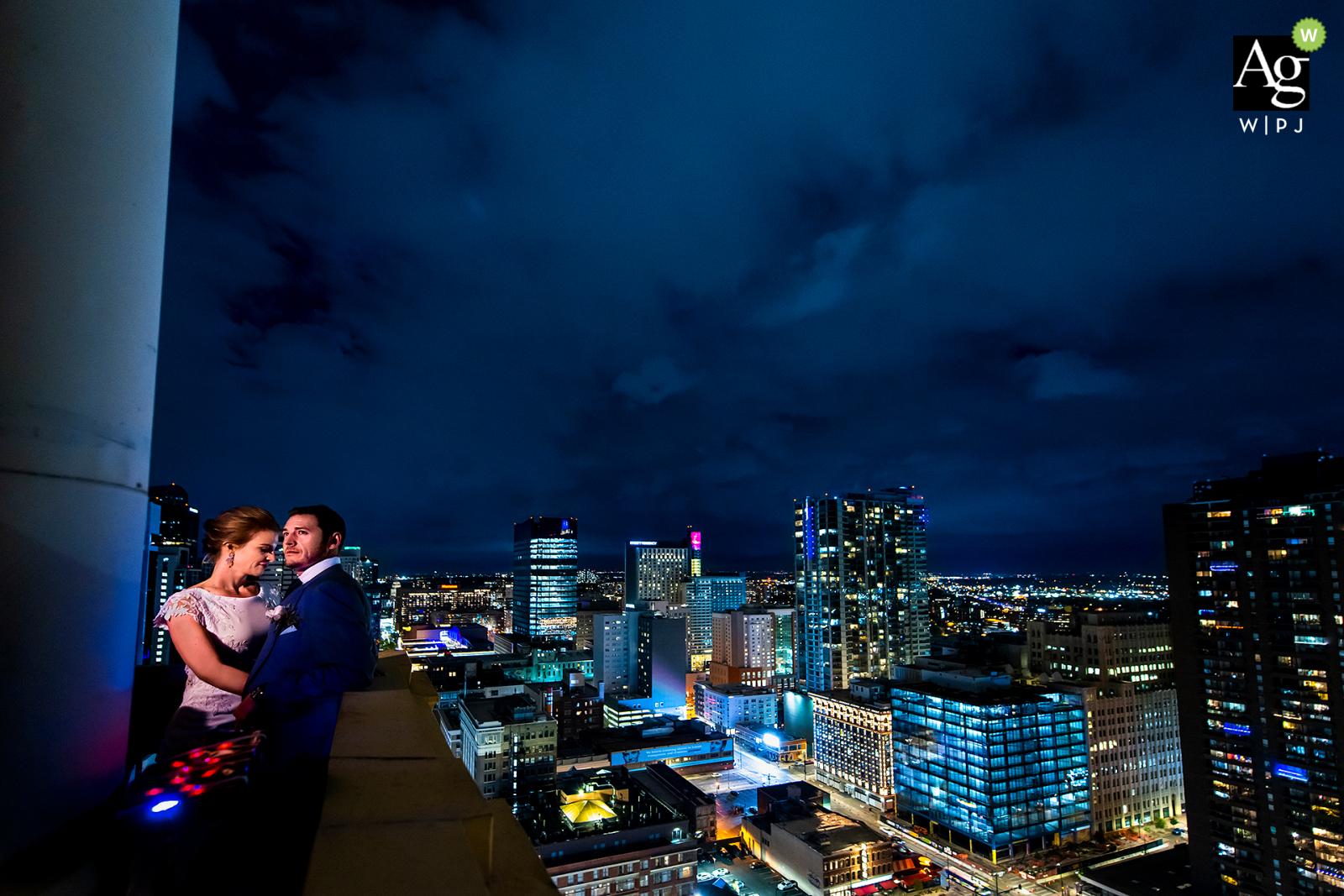 Daniels and Fisher Tower, Denver, CO artistic wedding couple portrait of the bride and groom against the Denver skyline at night