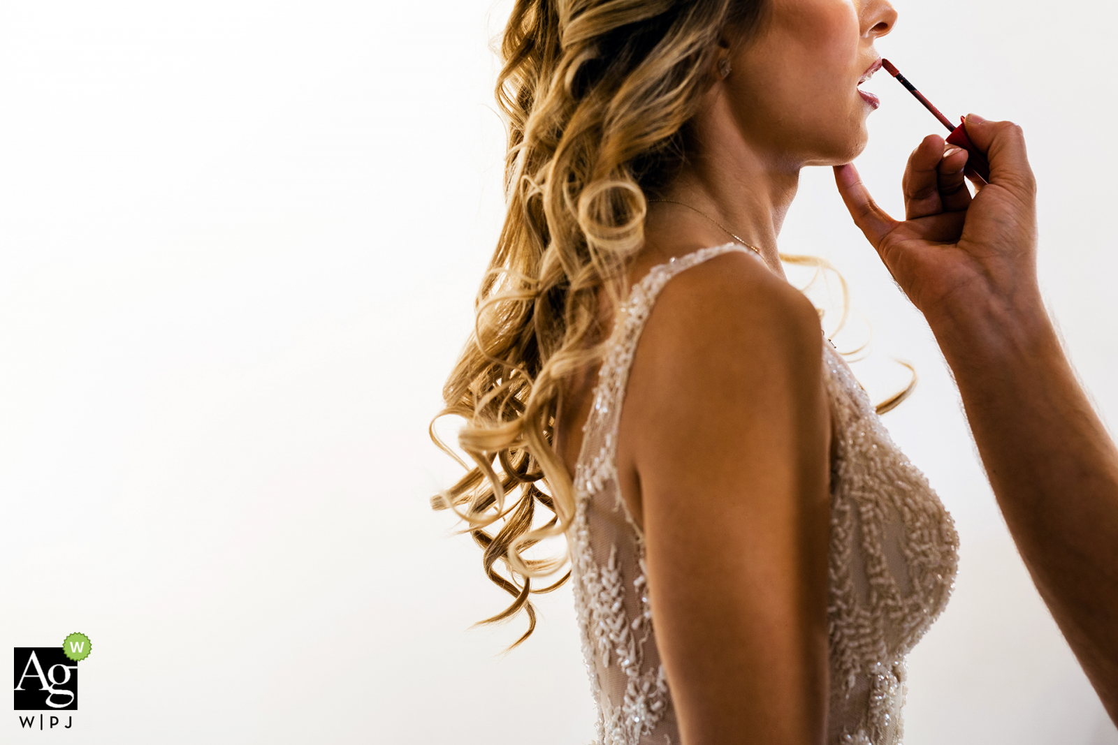 Istanbul fine art wedding detail photography picture created as bride's getting ready against all white background with her lipstick
