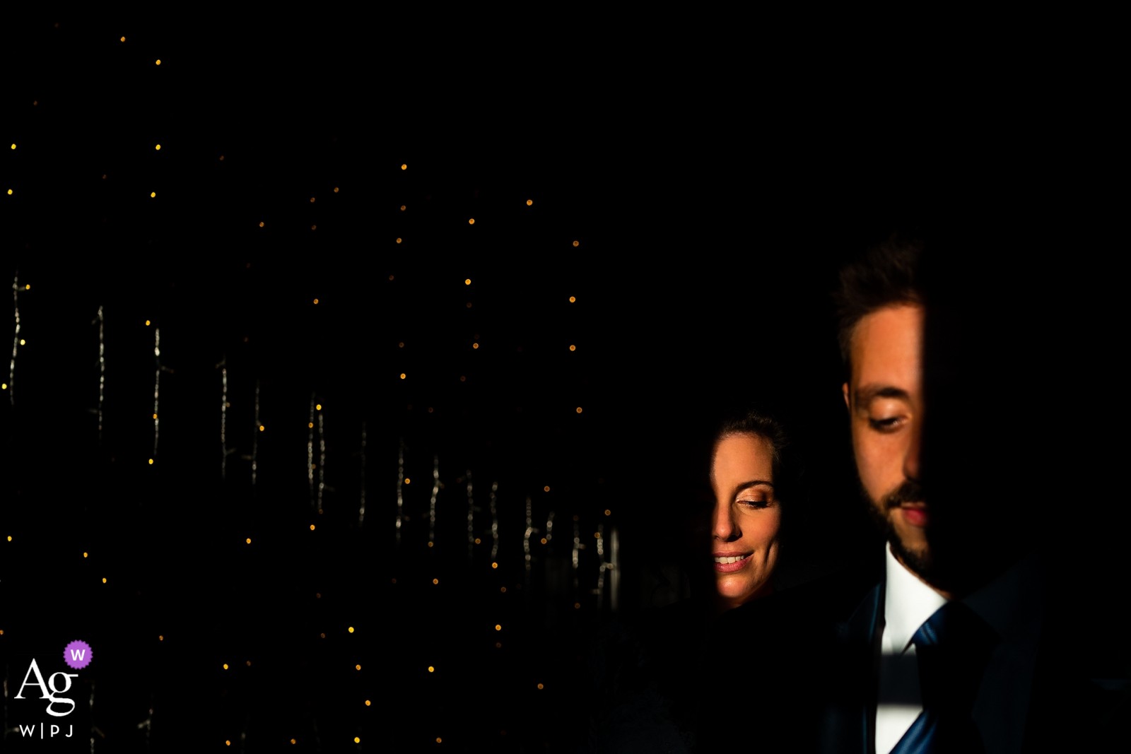 Artistic wedding photo from Stanjel Castle, Slovenia with the couple, Lights and shadows