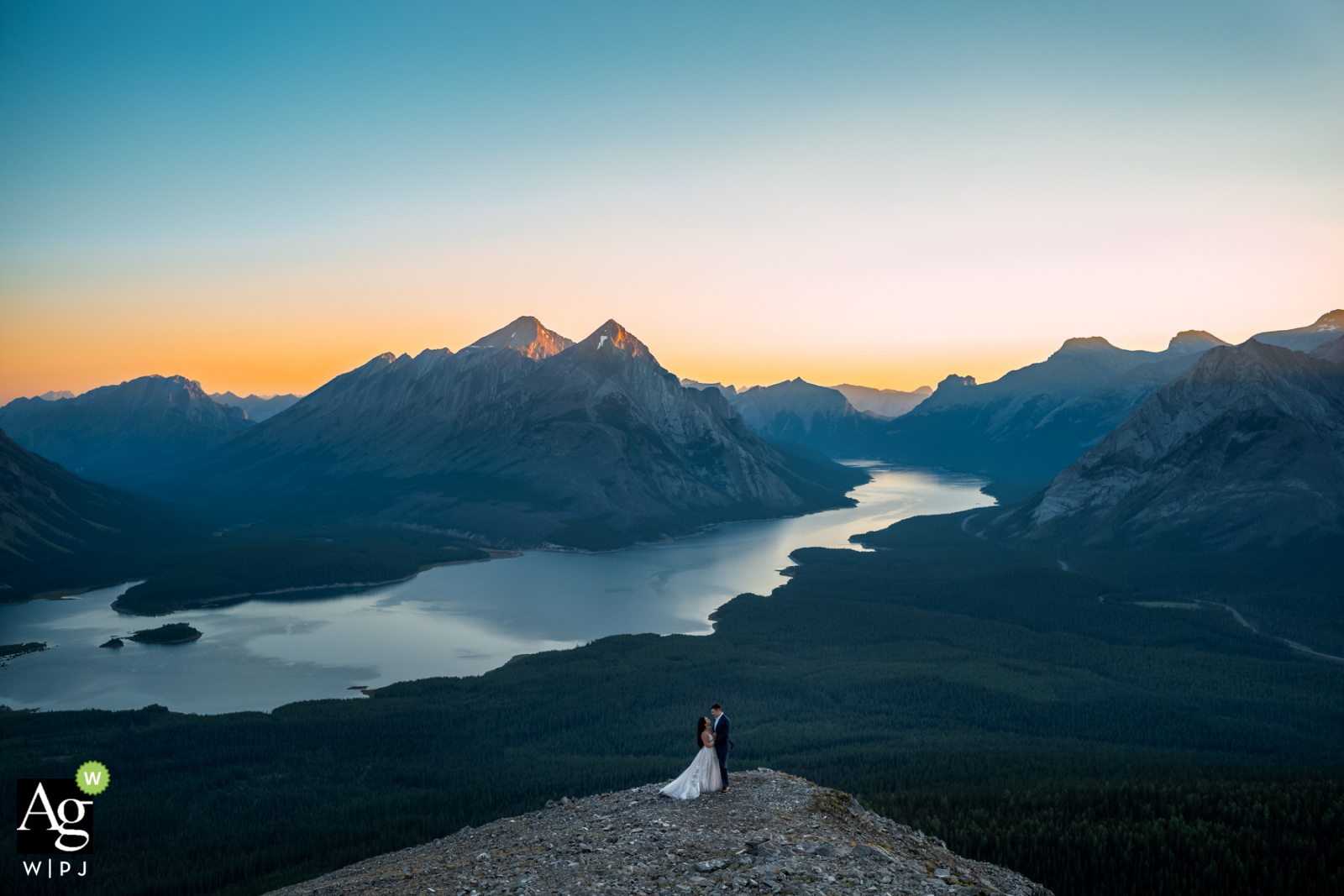Tent Ridge, Kananaskis, AB, Canada creative wedding day portrait with the couple and some Admiration of the sunrise
