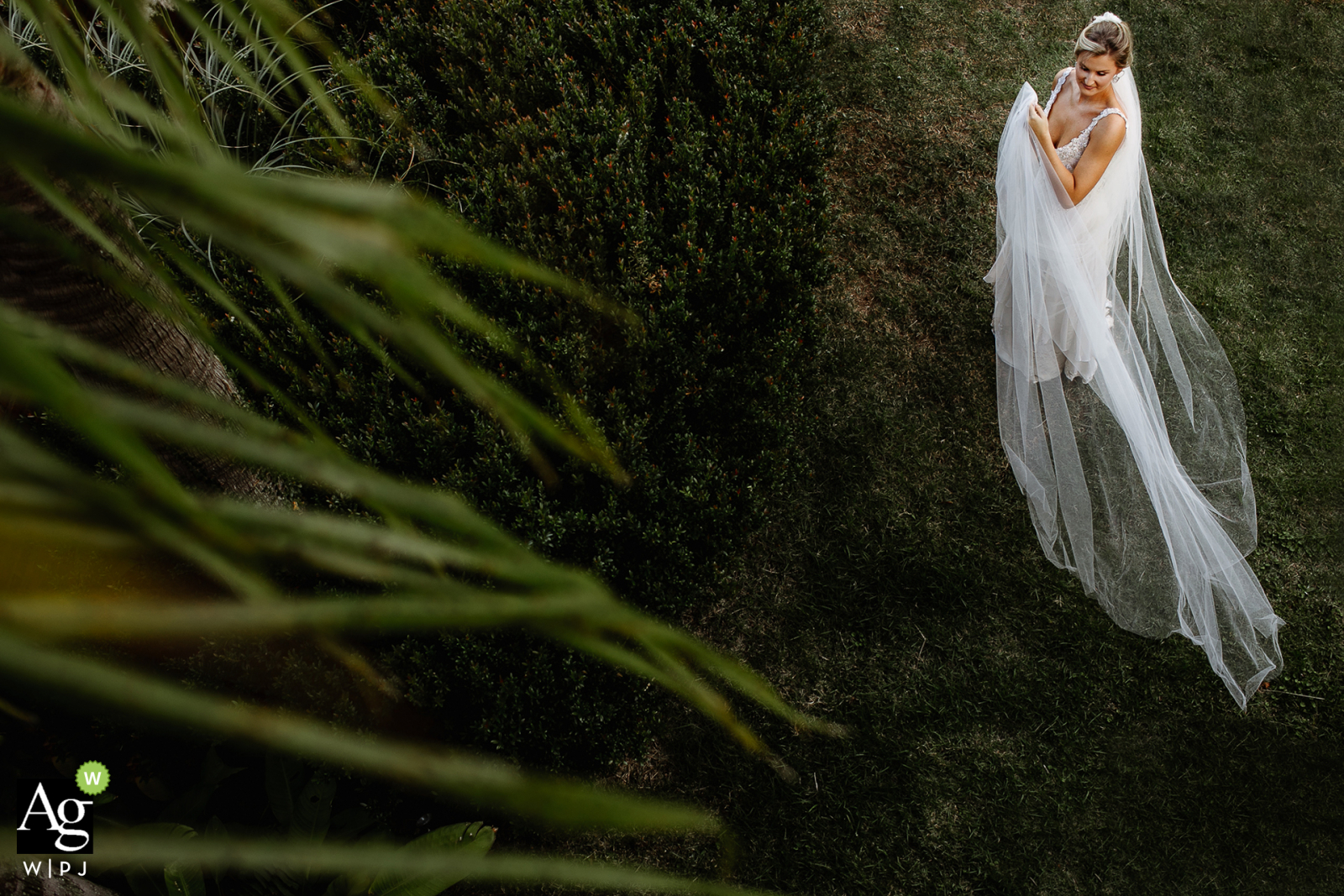 Casa da Noiva fine art wedding portrait image from the House of the Brideas she is spinning her veil on the lawn