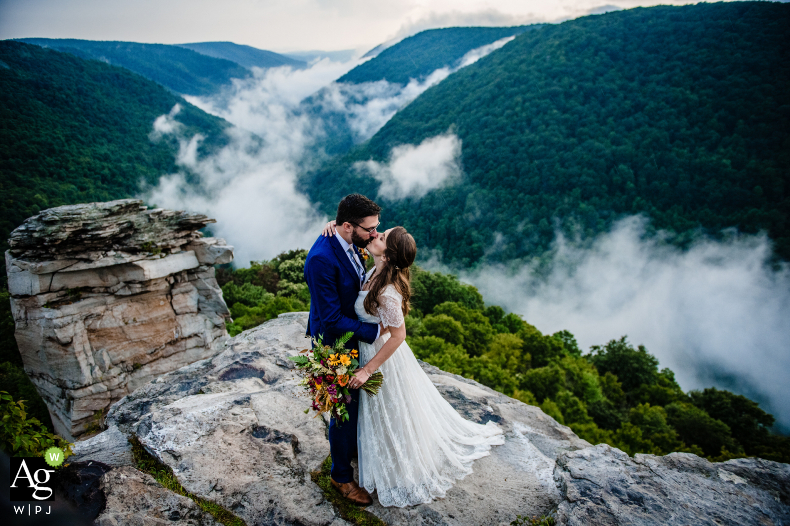 Washington DC, United States couple posing for a Wedding Portrait after elopement on the rocks above the clouds and valley belowt
