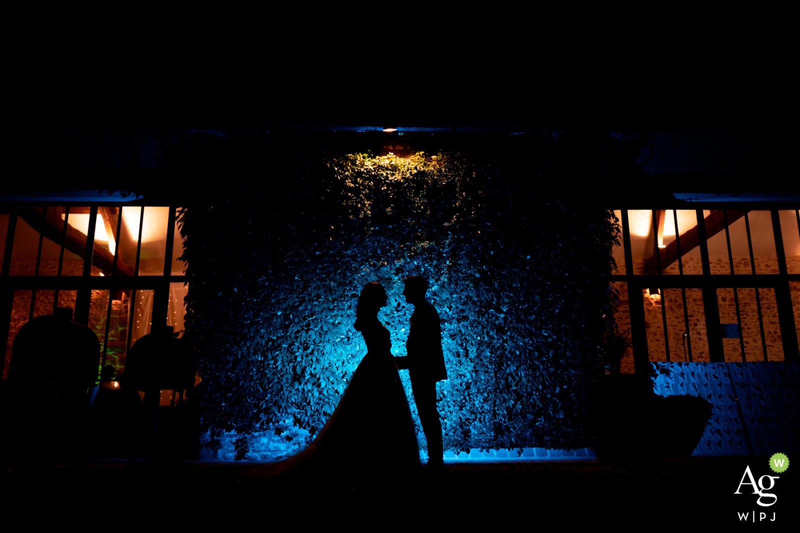 Les Hauts de Pardaillan, France couple posing for a wedding Night shot during dinner