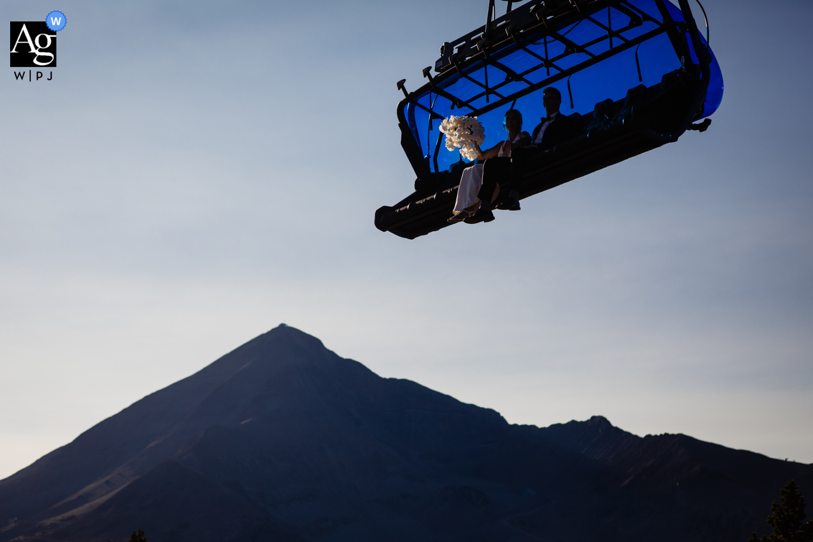 Montana big sky artistic wedding photo showing a bouquet on chairlift at the ski resort