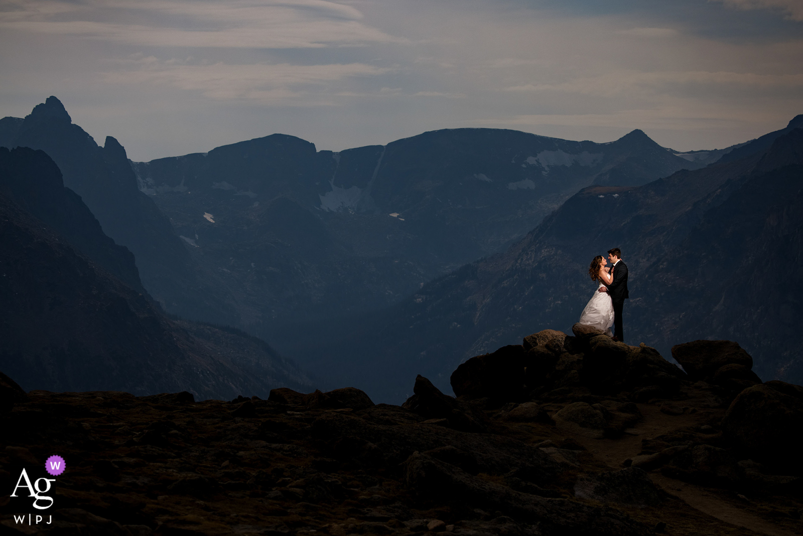 RMNP artistic wedding photo pose of a couple together atop Trail Ridge Road in Rocky Mountain National Park