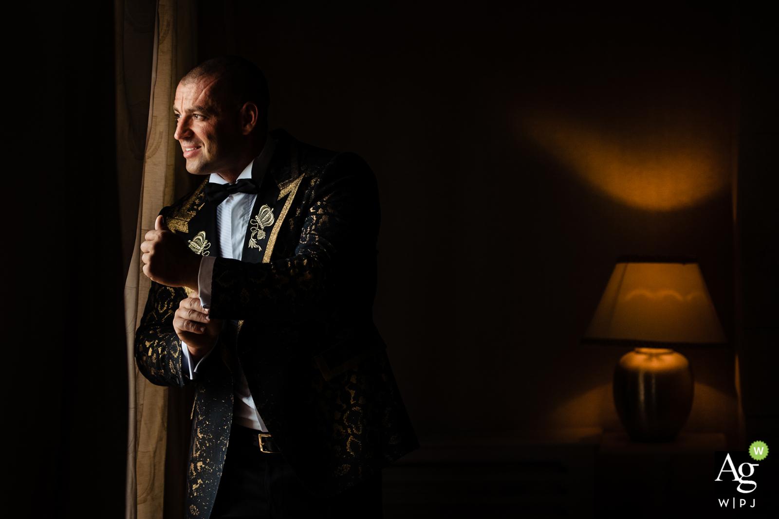 St. Sofia Golf Club Portrait of the groom next to the window