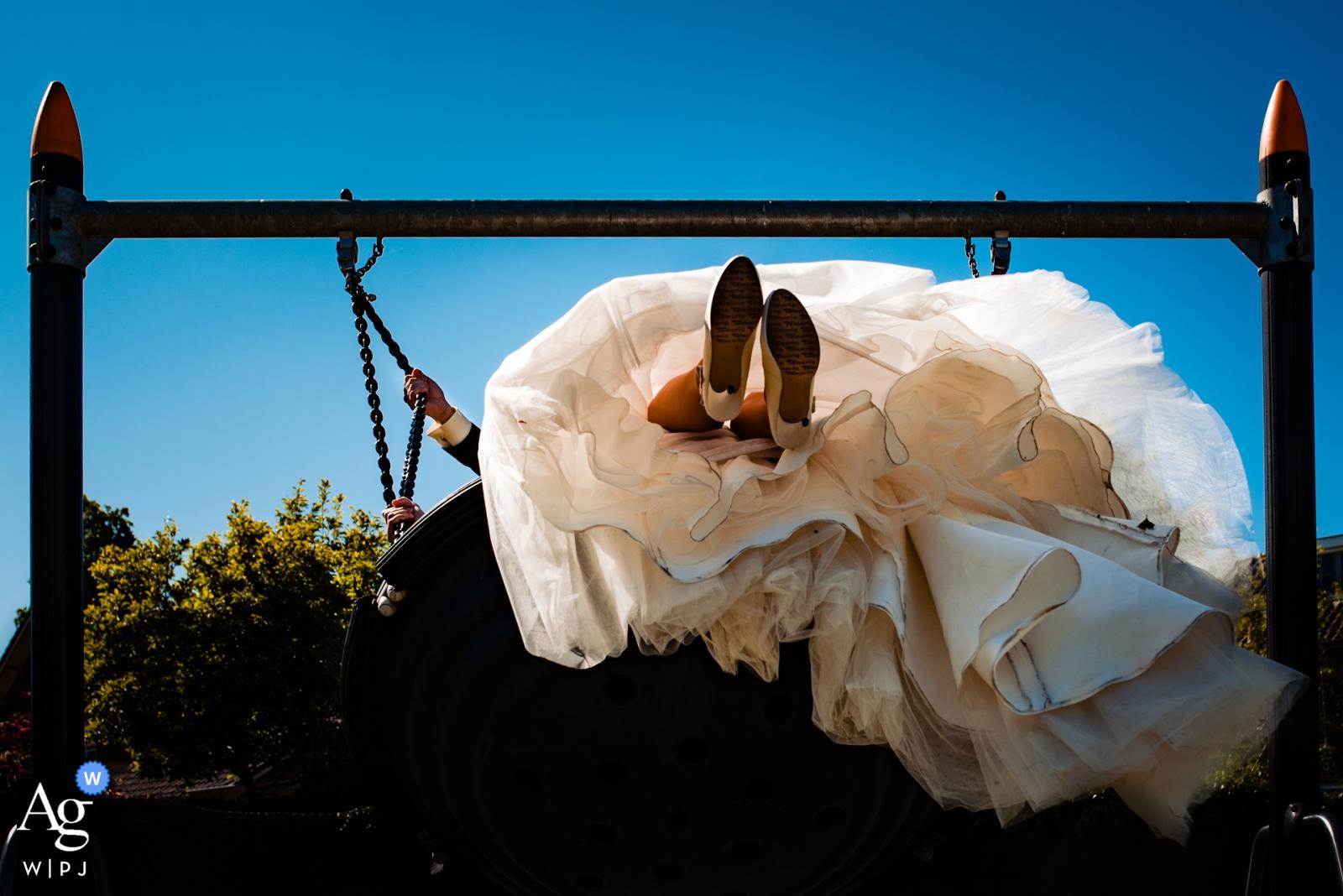 Heusden City artistic wedding Swing along photo against a blue sky