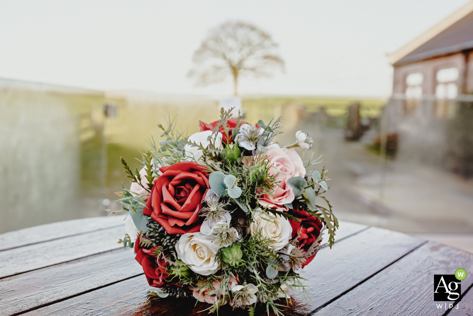 Heaton House Farm, Manchester, England wedding detail photographyshowing the brides bouquet with tree in background