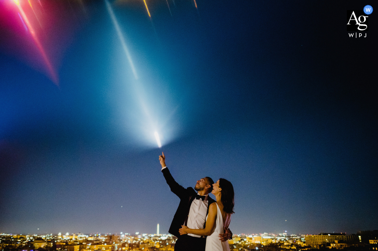 The Line, DC artistic wedding photo showing the groom is touching the shooting star