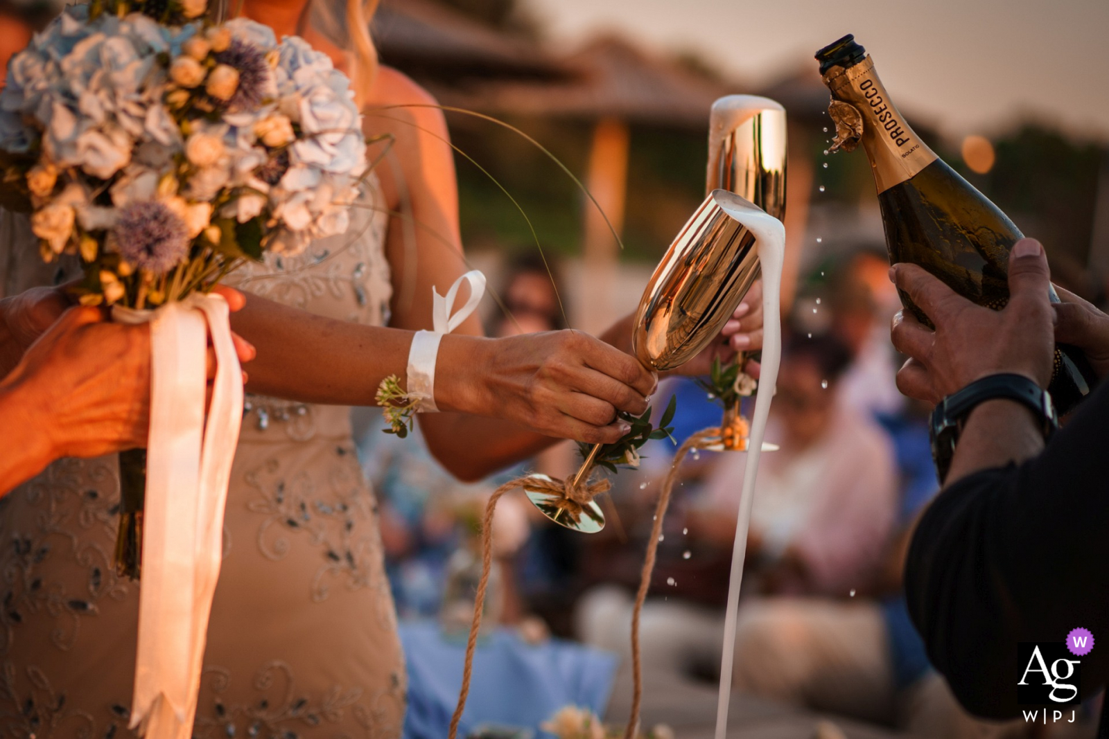 Black Sea wedding detail image of the best man pouring champagne during the ceremony at Papur Beach and Bar