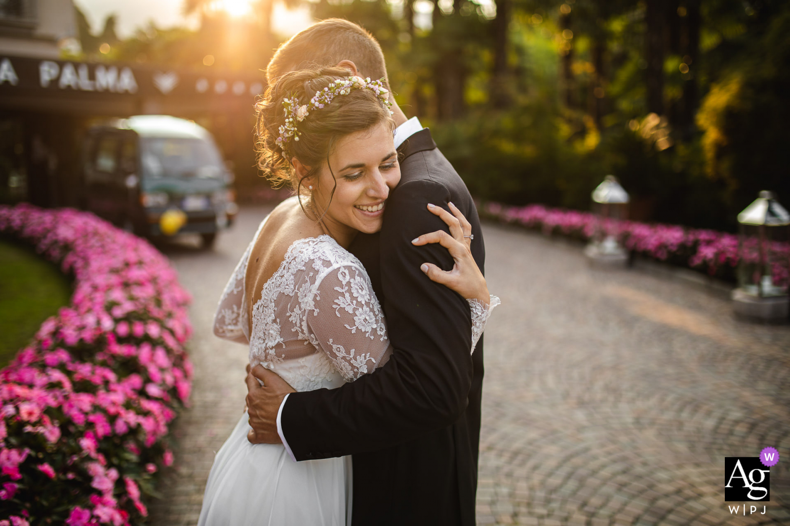 Hotel La Palma Stresa Italy couples Hug at the sunset artistic wedding portrait by the flowers