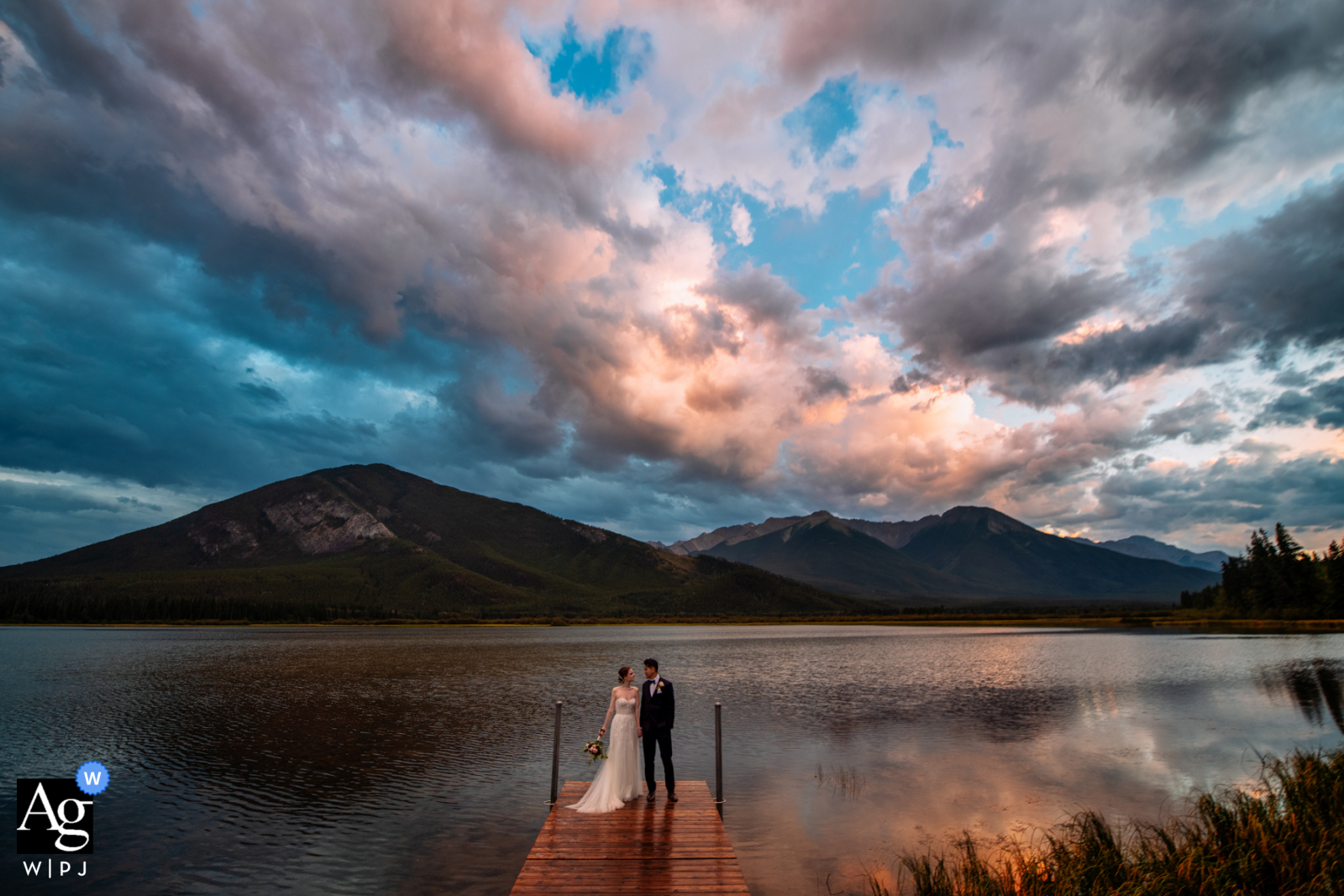 Vermilion Lakes at sunrise portrait of the bride and groom by an Edmonton wedding photographer