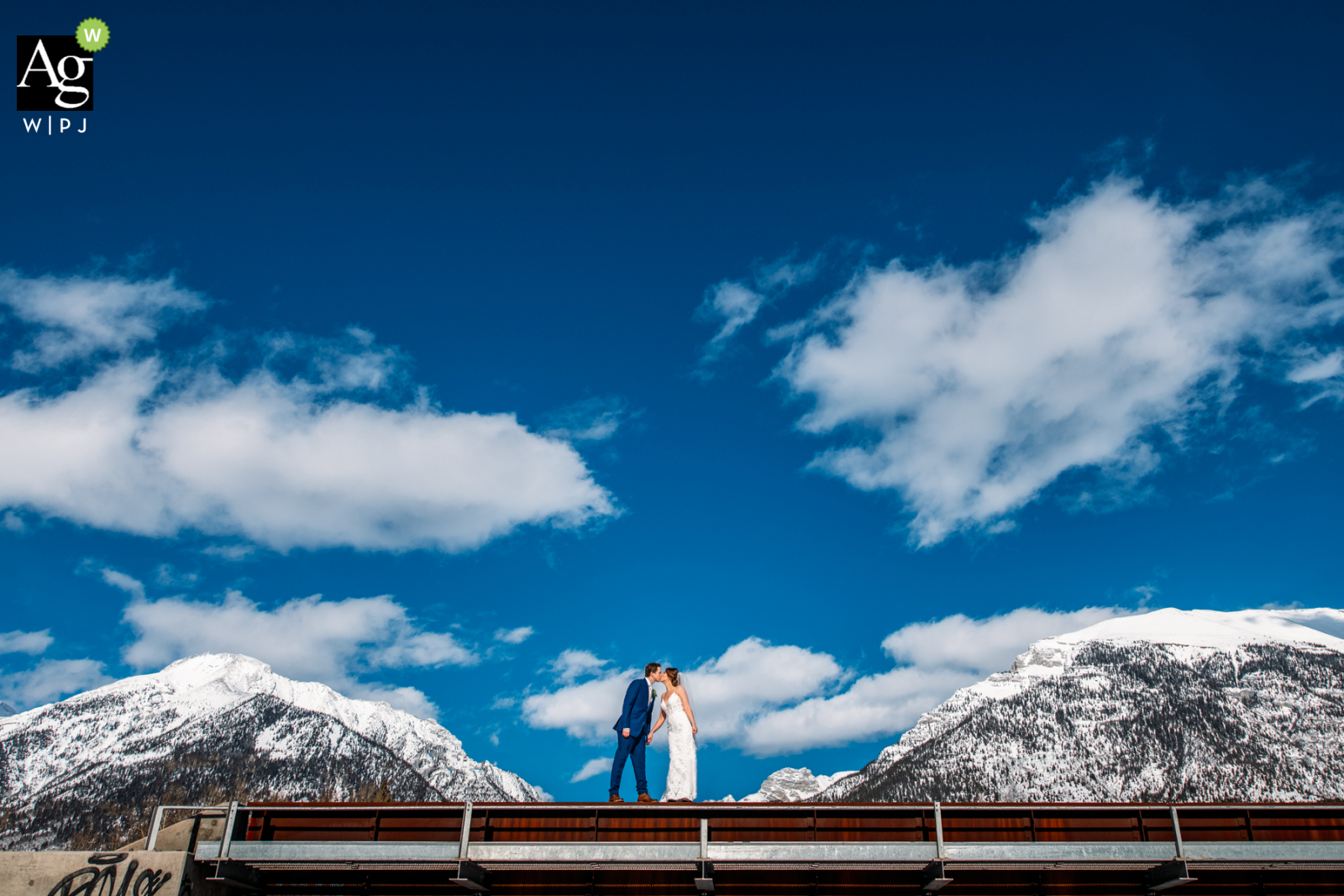 AB couple posing for a wedding picture at Silvertip Golf Resort , Canmore, AB, Canada, Between the mountains