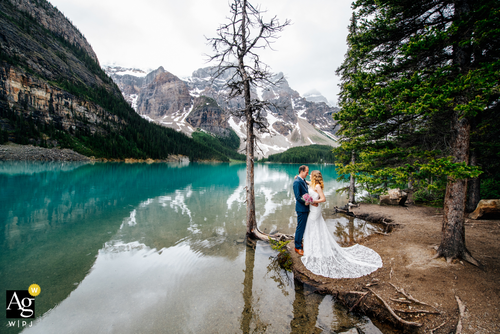 Alberta couple hold each other in this portrait at Moraine Lake