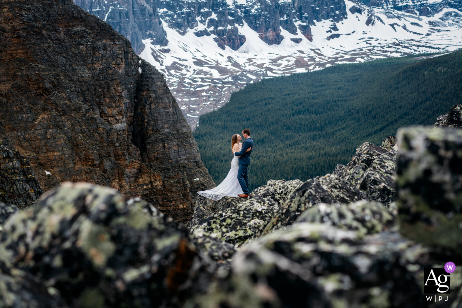 Alberta Artistic Wedding Photographer captures this bride and groom together at the Tower of Babel, Banff National Park