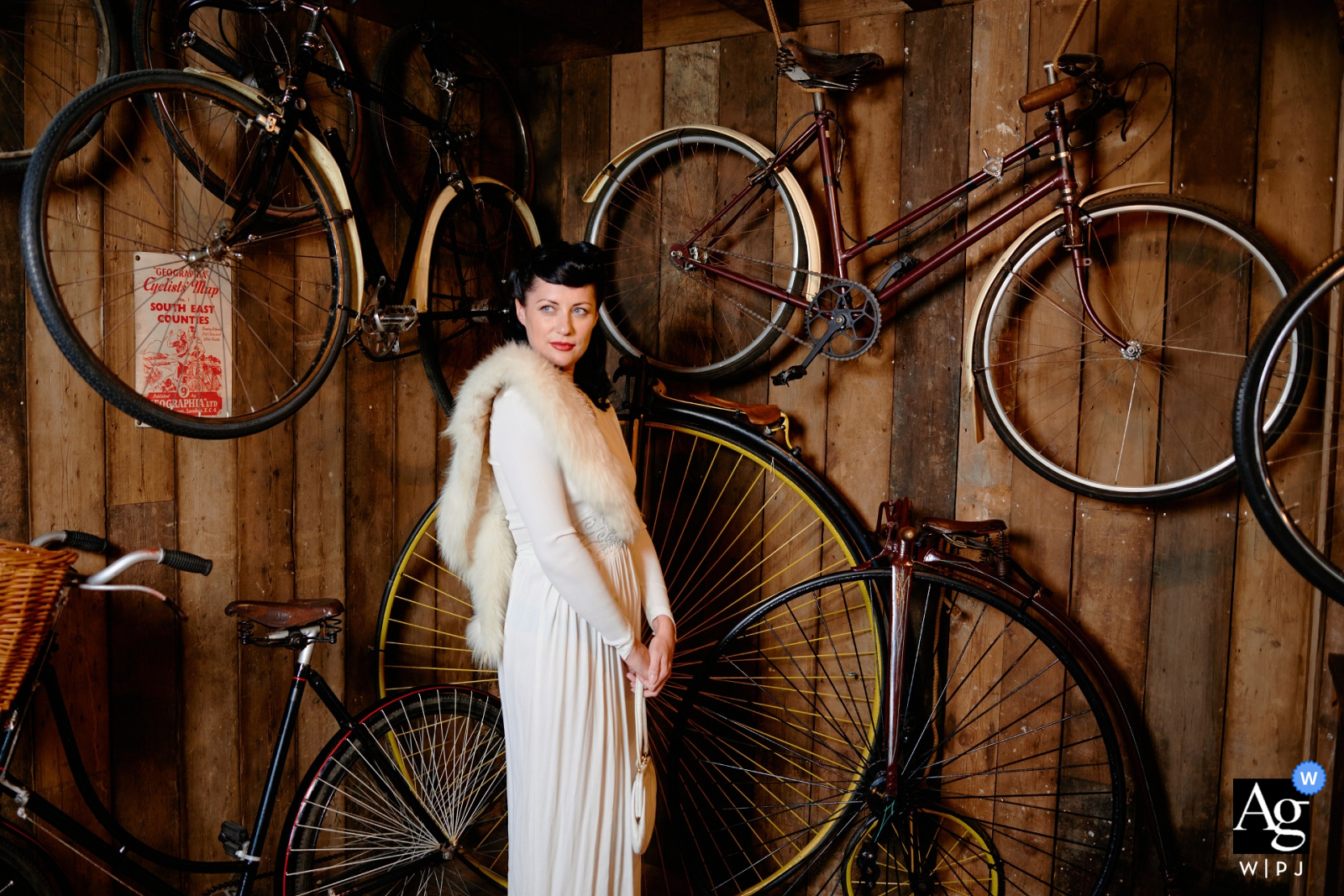 Hampshire, England creative wedding bridal portrait session in warm tones against a wood wall with hanging bikes