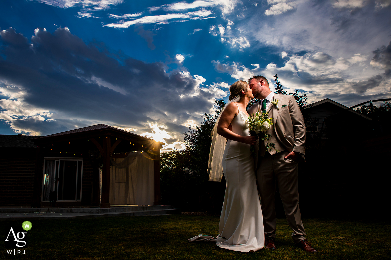 Thornton, CO sunset portrait of bride and groom during their backyard wedding
