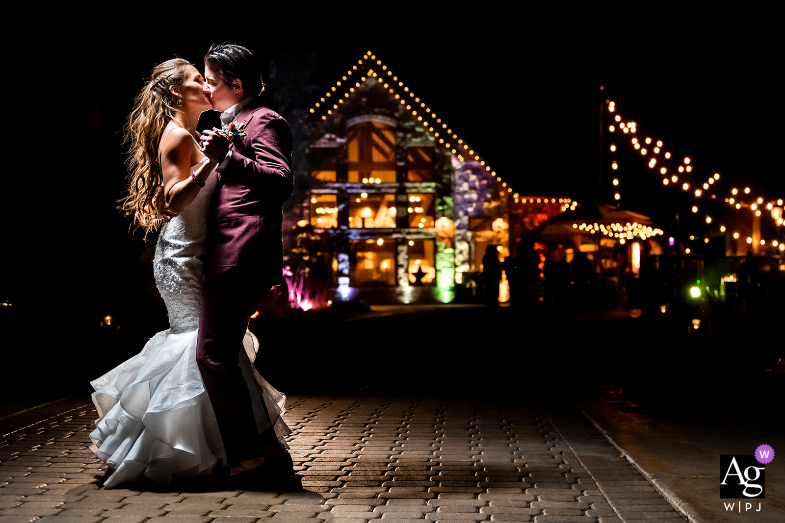Della Terra Mountain Chateau, Estes Park, CO creative nighttime portrait of bride and groom with cool venue at night