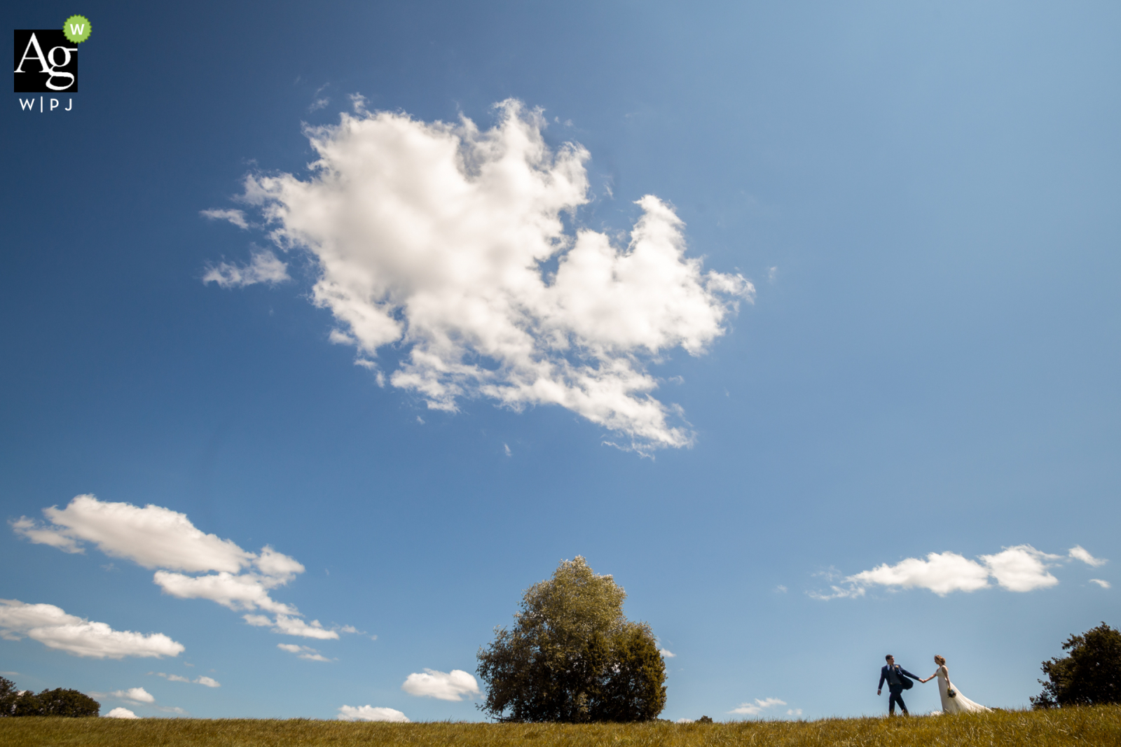 Albi, South of France wedding couple posed portrait session of the bride and groom walking underneath the clouds