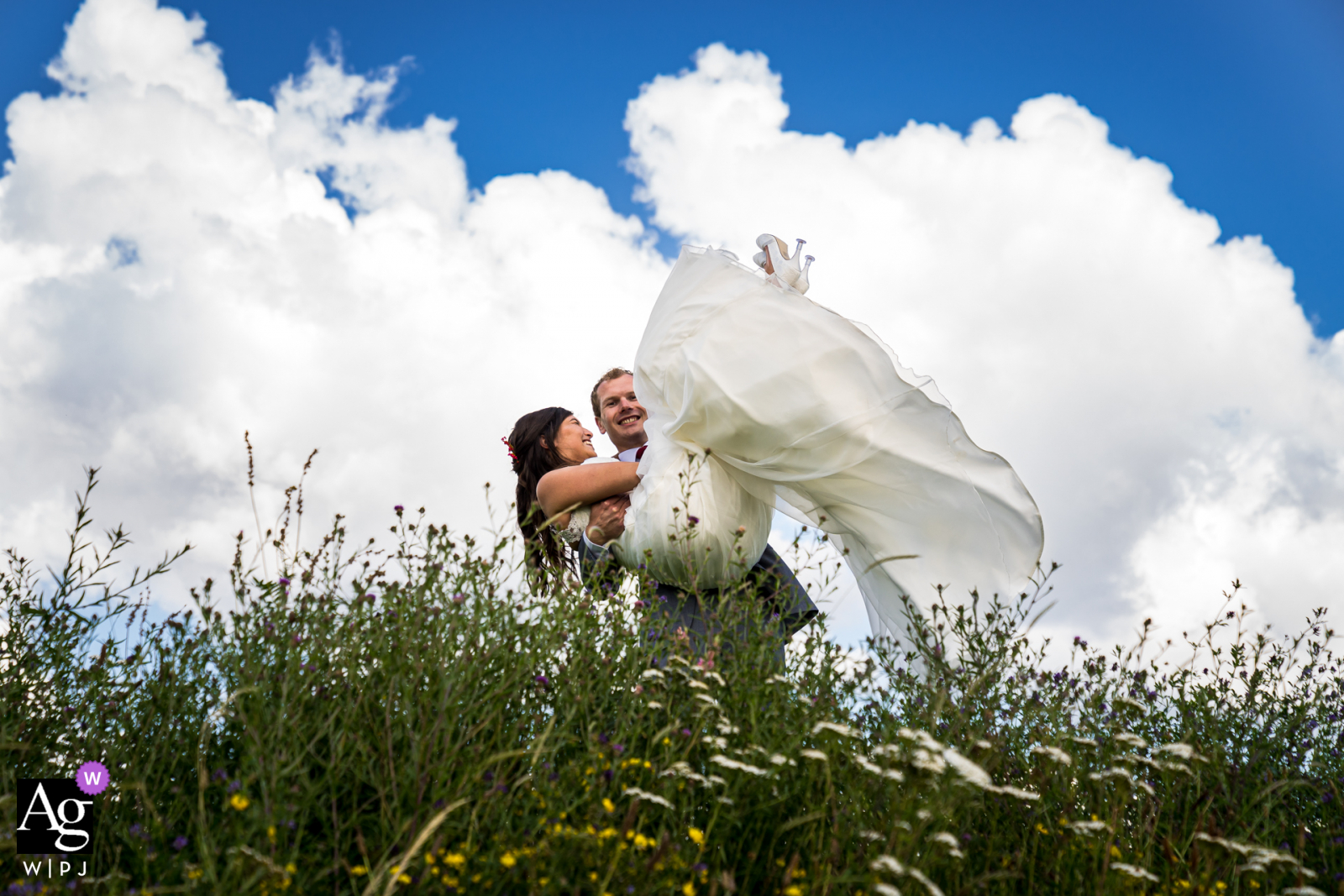Benedensas in the Heen creative couple wedding portrait while having fun, groom is lifting the bride