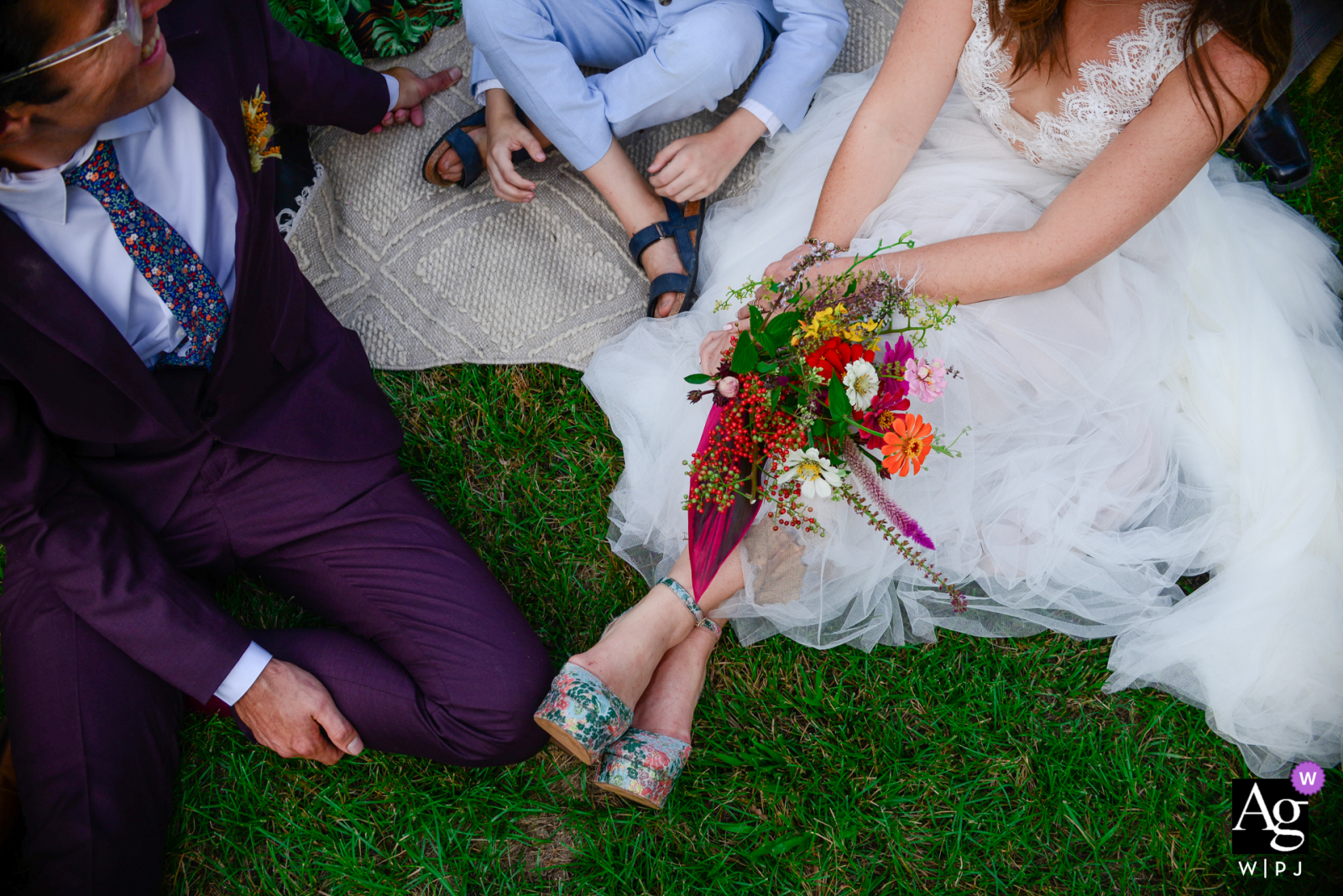 Sow Exotic Farm in Winter Haven, FL fine art wedding bride flowers detail image showing the Family relaxing together right after ceremony