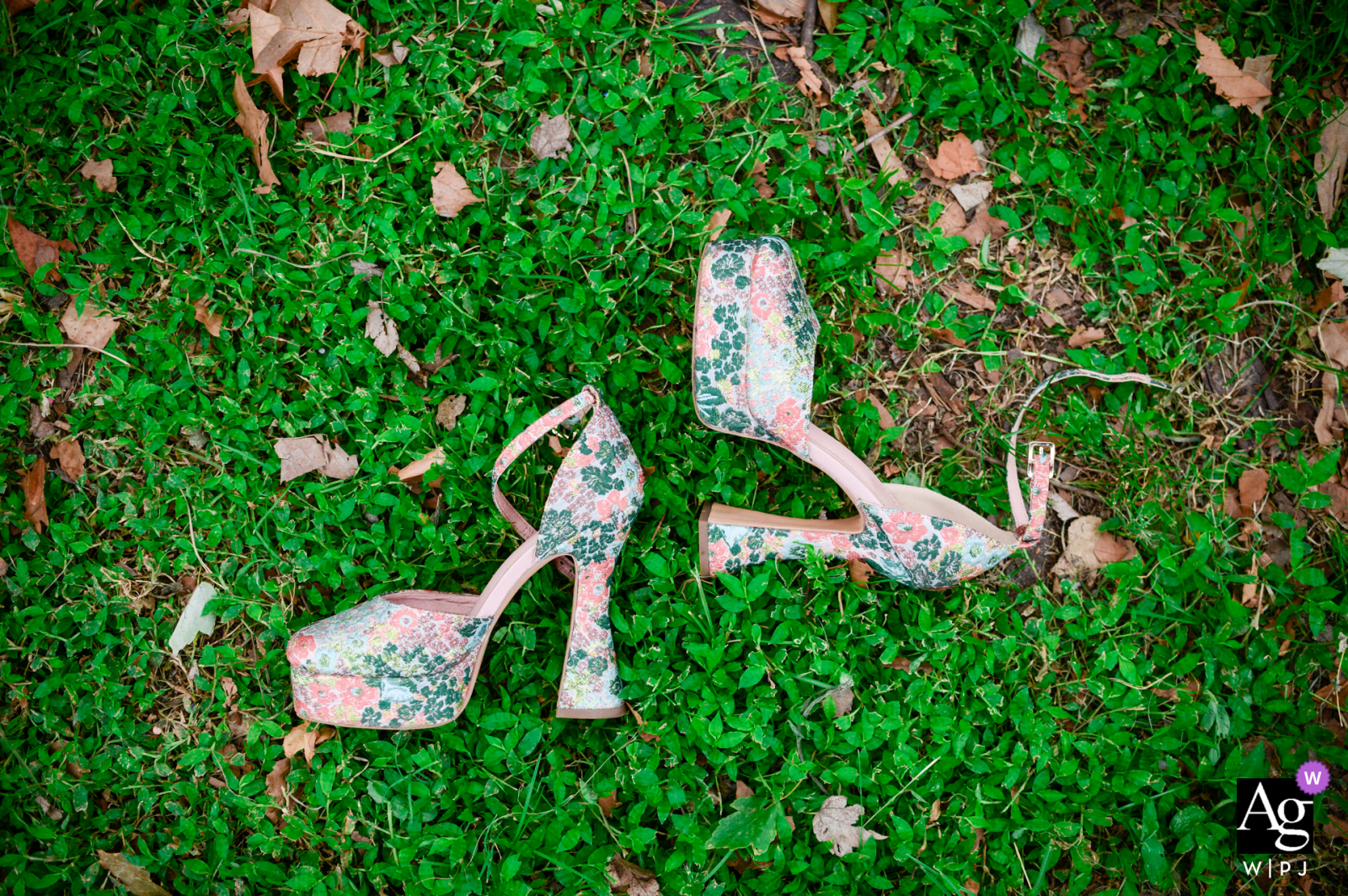 Sow Exotic Farm in Winter Haven, FL fine art wedding flowered shoes detail image of Bride's shoes in the grass before the ceremony begins