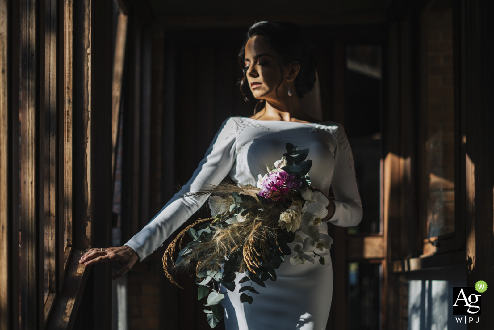 """Federal District bride posing for wedding images by Brasilia wedding photographer """"Moments before the ceremony began, we had a few minutes to make portraits, and the bride Maíra stopped on that stairway where she had sunlight to breathe"""""""