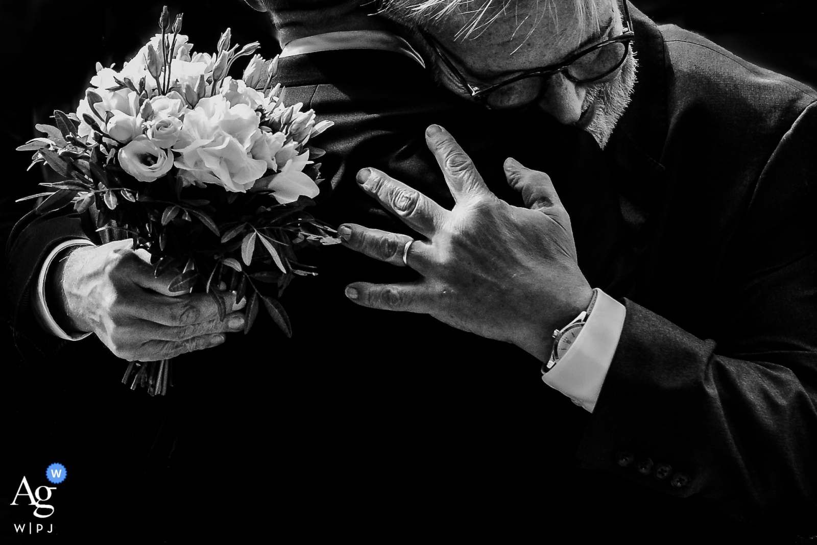 Lille, Hauts-de-France fine art wedding flowers picture showing The father of the bride making a hug to the groom