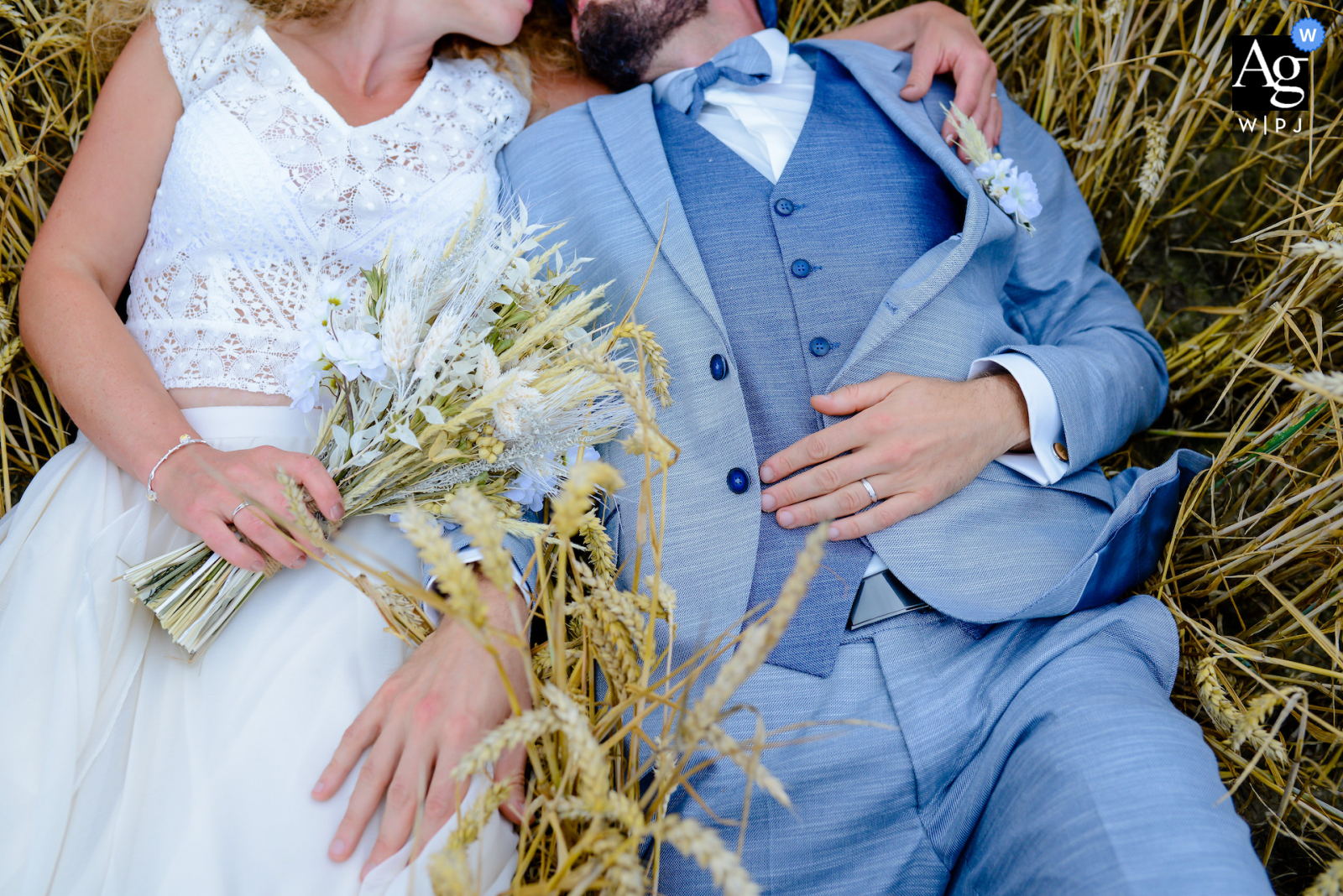 Lille, Hauts-de-France creative fine art wedding clothing picture during a moment of relaxation in the wheat field next to the place of reception