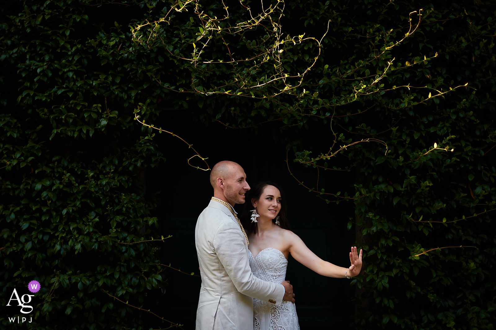Certaldo, Tuscany creative and natural wedding couple portrait while showing off the brides ring