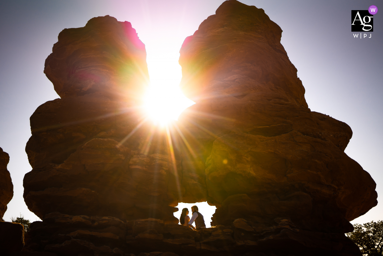 Garden of the Gods Park - Colorado Springs, Colorado bride and groom pose for portraits after their sunrise wedding ceremony