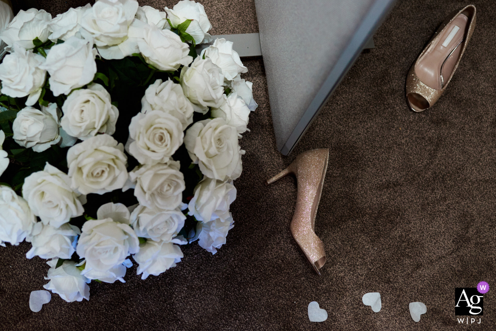 Creative detail wedding photo from a Private venue, Birmingham, UKof Wedding shoes on the floor