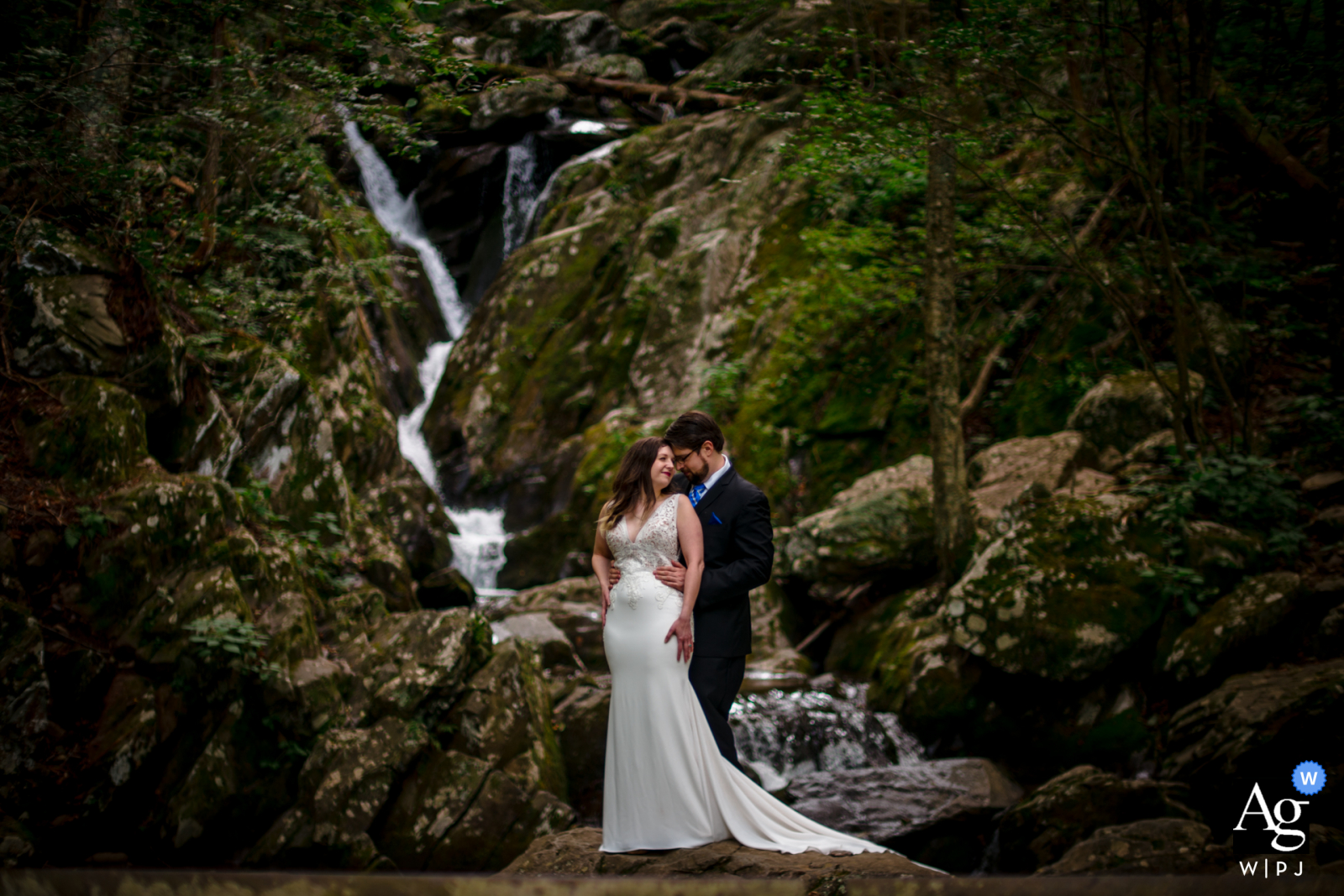 VA artistic wedding photo from Shenendoah, Virginia created as the Couple embraces in front of a waterfall