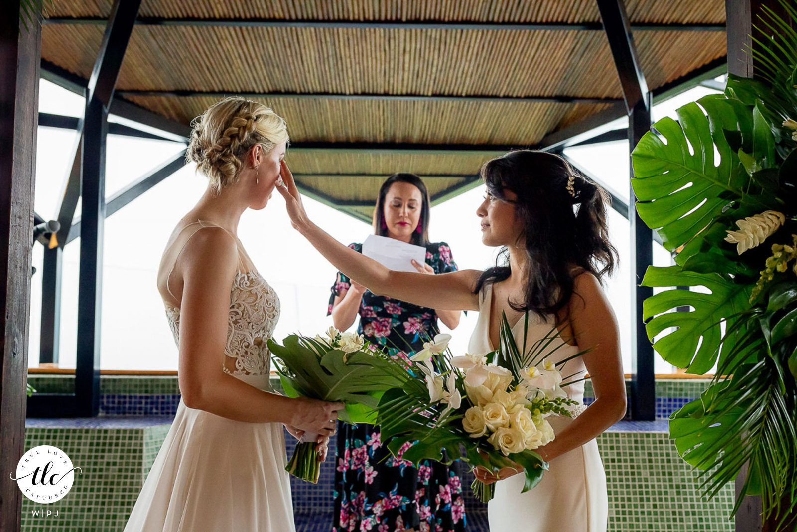 Punto de Vista, Manuel Antonio, Costa Rica emotional ceremony moment pic created as bride wipes tear from her soon to be wife