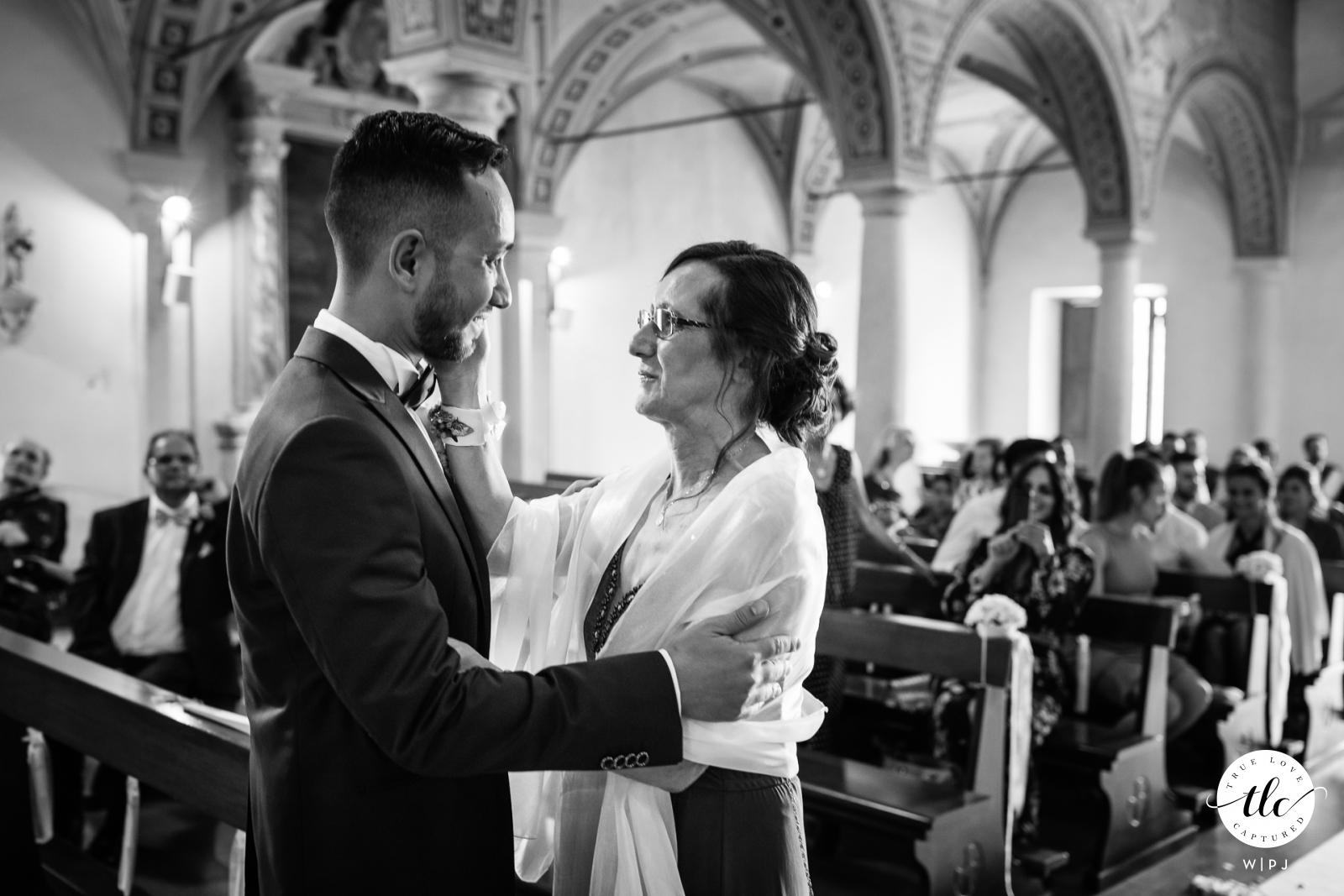 Chiesa Santa Maria Pregassona Lugano (CH) documentary wedding photo of the mother accompanying the groom to the altar
