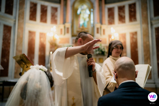 Napoli Italy Elopement Photography | The couple is Kneeling at the church altar together