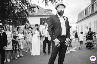 City Hall of Pontault Combault, France Elopement Photographer | Guests gather around in the street outside the city hall where the groom waits, blindfolded for the bride