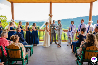 Smoky Mountain Elopement Photography | The ceremony begins on the outside deck of a rental